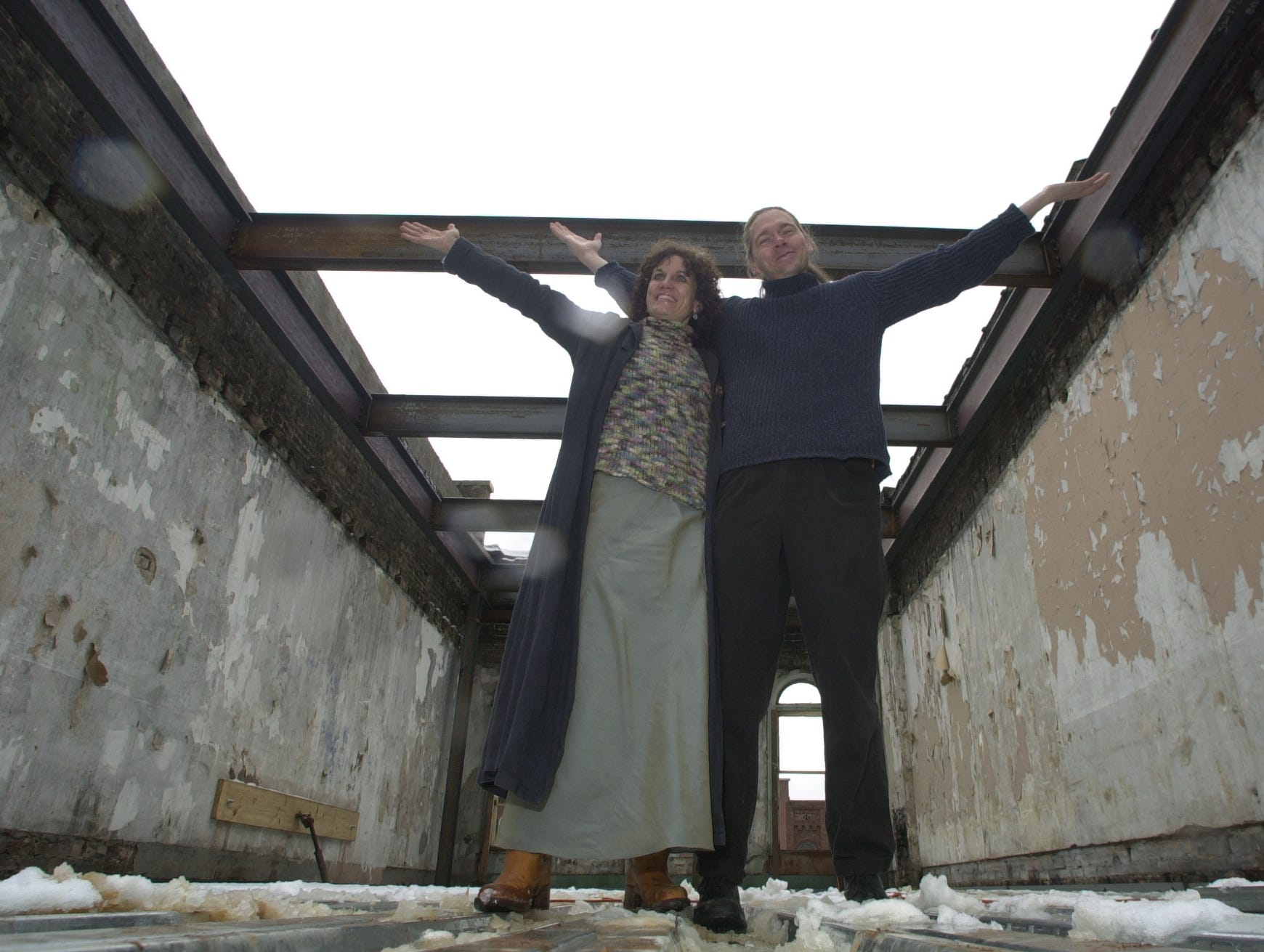 Earth to Old City and Preservation Pub owners Scott and Bernadette West pause in the upper story of one of their new properties Monday at Market Square. The couple, along with Bernadette West's mother, Rosemarie Trent, are now the largest single property owners on Market Square. 