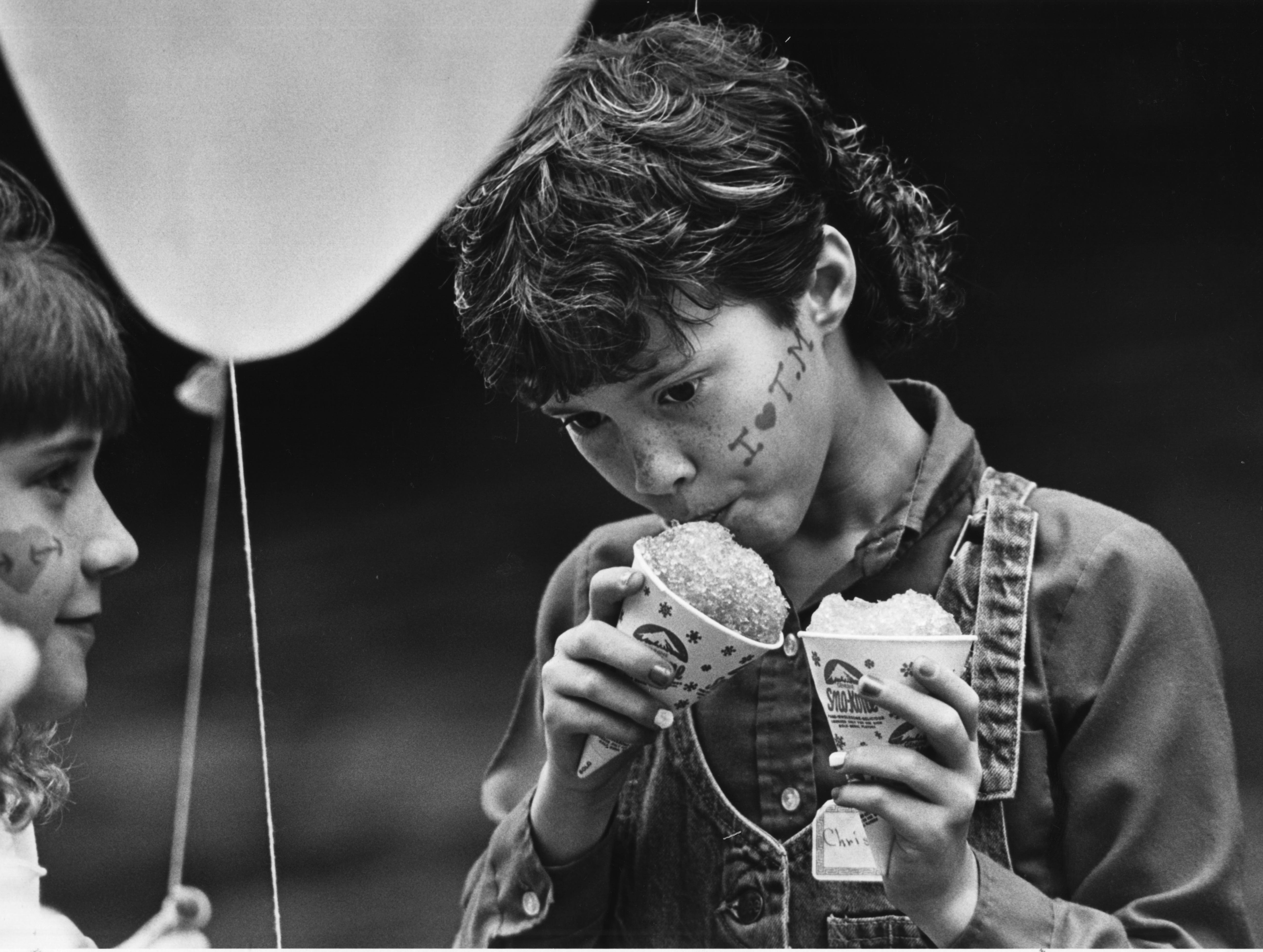 Christie Smith, 9, found the snow cones doubly delicious April 15, 1987 during the Dogwood Arts Festival at Market Square. She was visiting the festival with her Rogersville City School fourth-grade classmates.