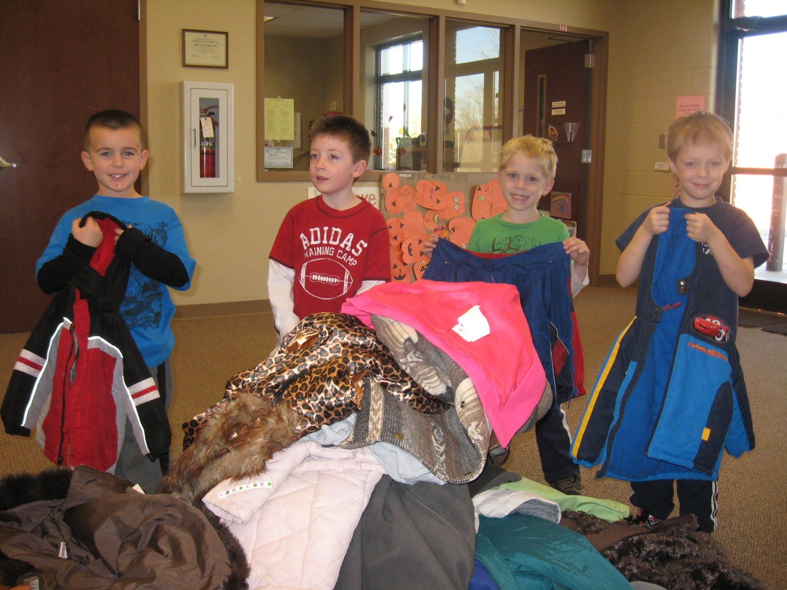 Kindergarten students from Faith Early Learning Center in Farragut collected coats for Knox Area Resuce Ministries' Coats for the Cold. The school collected 95 coats for the program. Students helping count coats and jackets are, from left, Wyatt Ford, William Wilson, Leo Karnitz and Brandon Wright.