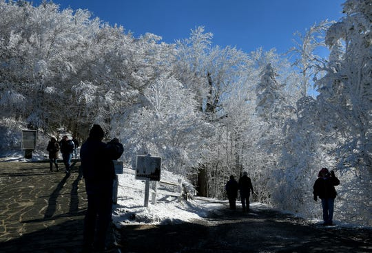 Visitors enjoying the snow at Newfound Gap along US441 from to the North Carolina state line Wednesday, Nov. 28, 2018.