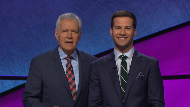 """Jeopardy!"" host Alex Trebek and Knoxville contestant Dylan Hamilton pose for a photo while on the show."