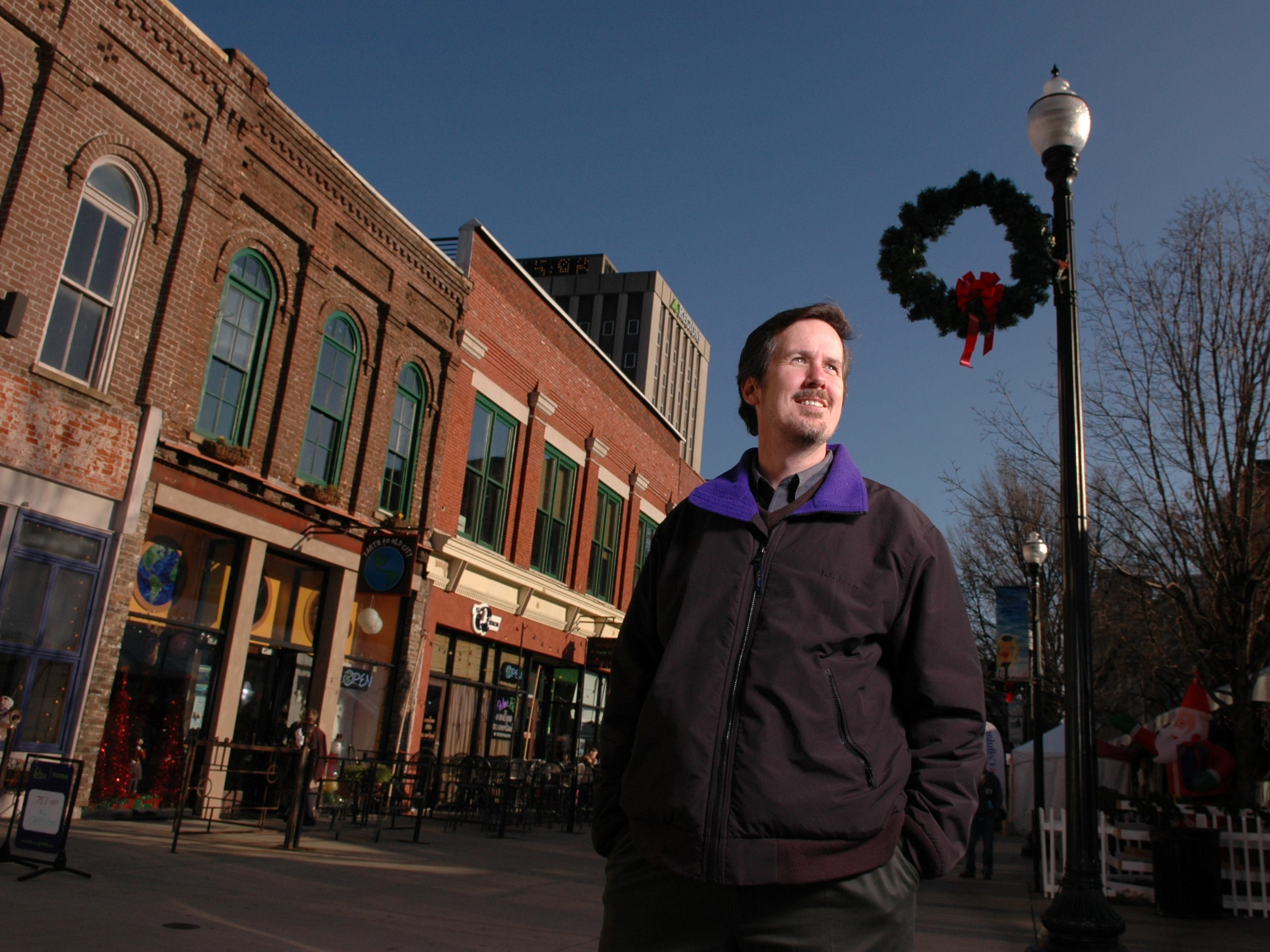 John Craig is the Market Square District Association president and is planning a New Year's Eve celebration on Market Square that will include ice skating, a ball drop, and fireworks. He is pictured here at Market Square on a sunny Thursday afternoon.