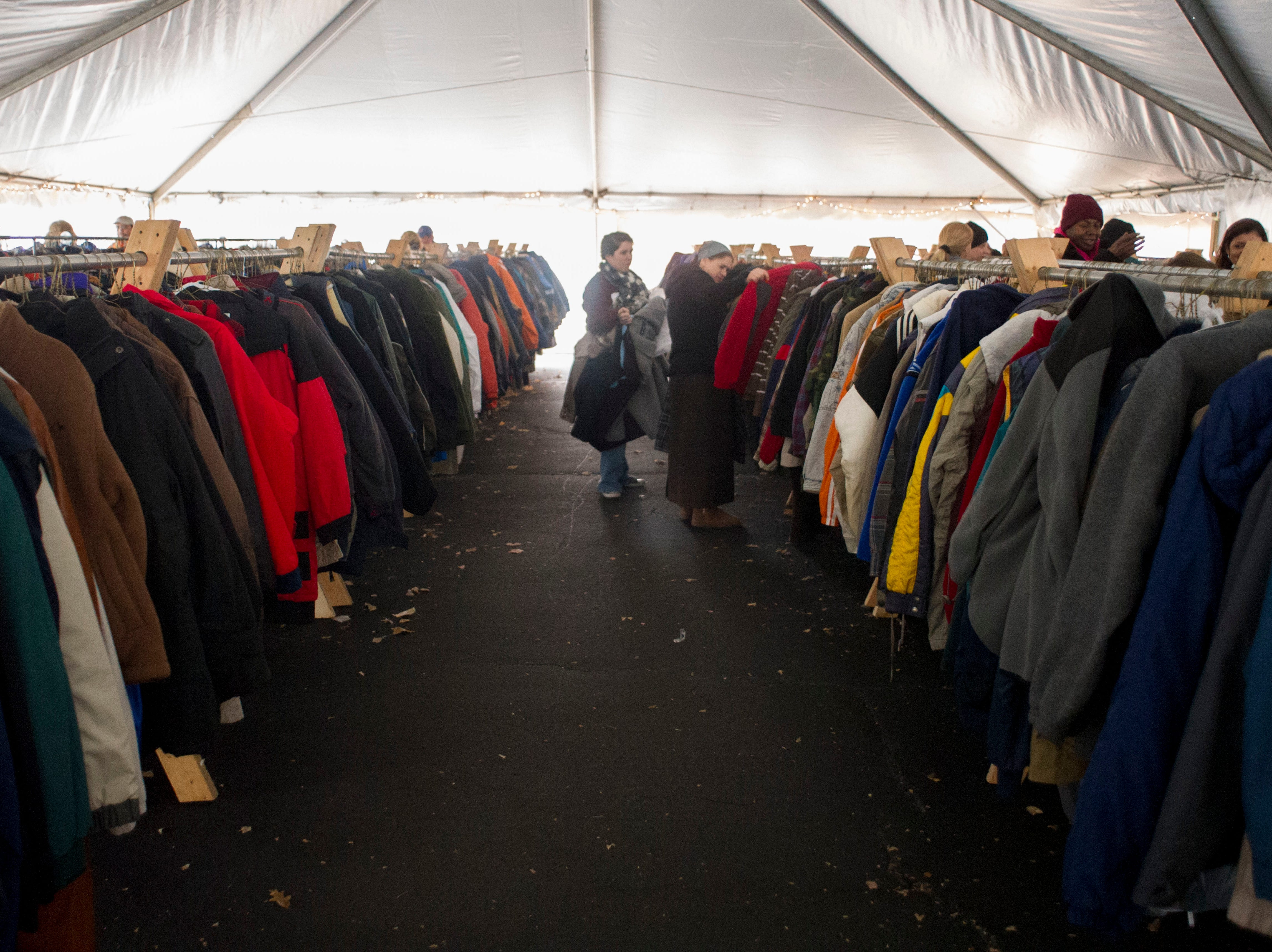 Close to 8000 coats fill a large canopy tent outside of the KARM Thrift Store on Saturday, December 1, 2012 during the Knoxville Area Rescue Ministries annual Coat for the Cold event. According to KARM president, Burt Rosen, they Ministriy will give out close to 2000 coats during the annual event.