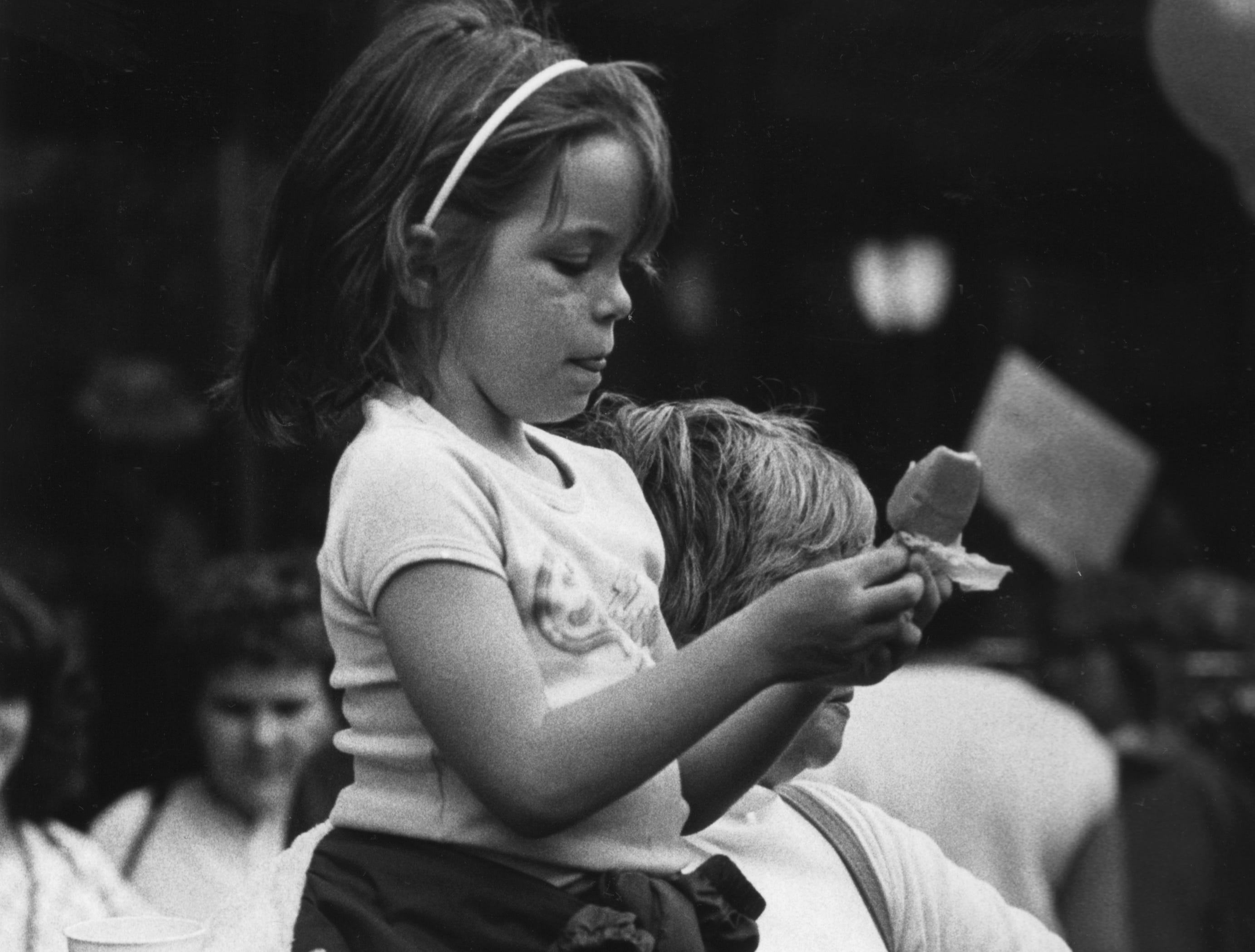 Collen Kispert, 8, enjoys an ice cream treat during the Dogwood Arts Festival April 14, 1984 at Market Square Mall. Colleen, the daughter of Ken and Marilyn Kispert, attended the festival with her grandmother, Jean Gillen, from Chicago, Ill.