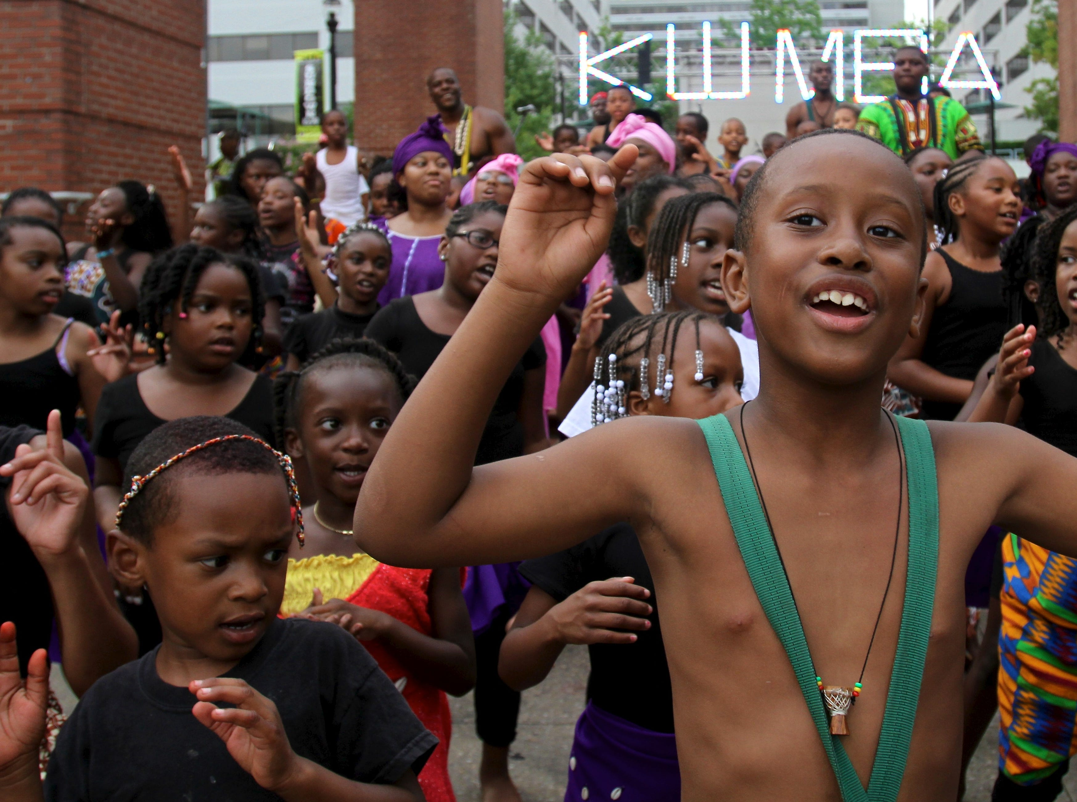 Children including Khalid Ajanka, 8, center, perform on Market Square after the annual Kuumba Festival's Junkanu parade on Friday, June 24, 2011.
