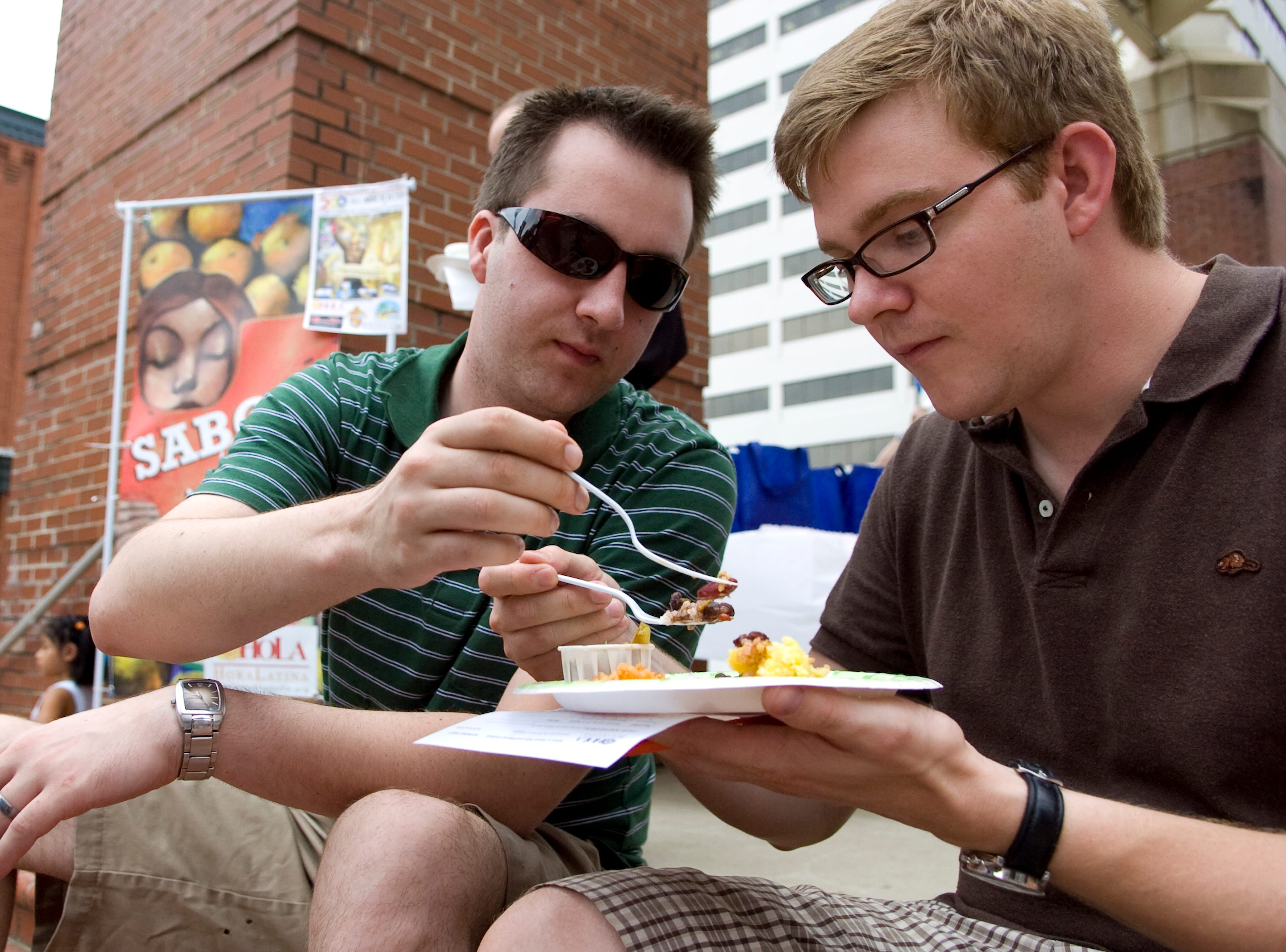 Evan Dunn, left, and Grant Cothran sample a variety plate of beans and rice during the Hola Festival's healthy beans and rice cook off at Market Square on Thursday, September 16, 2010.