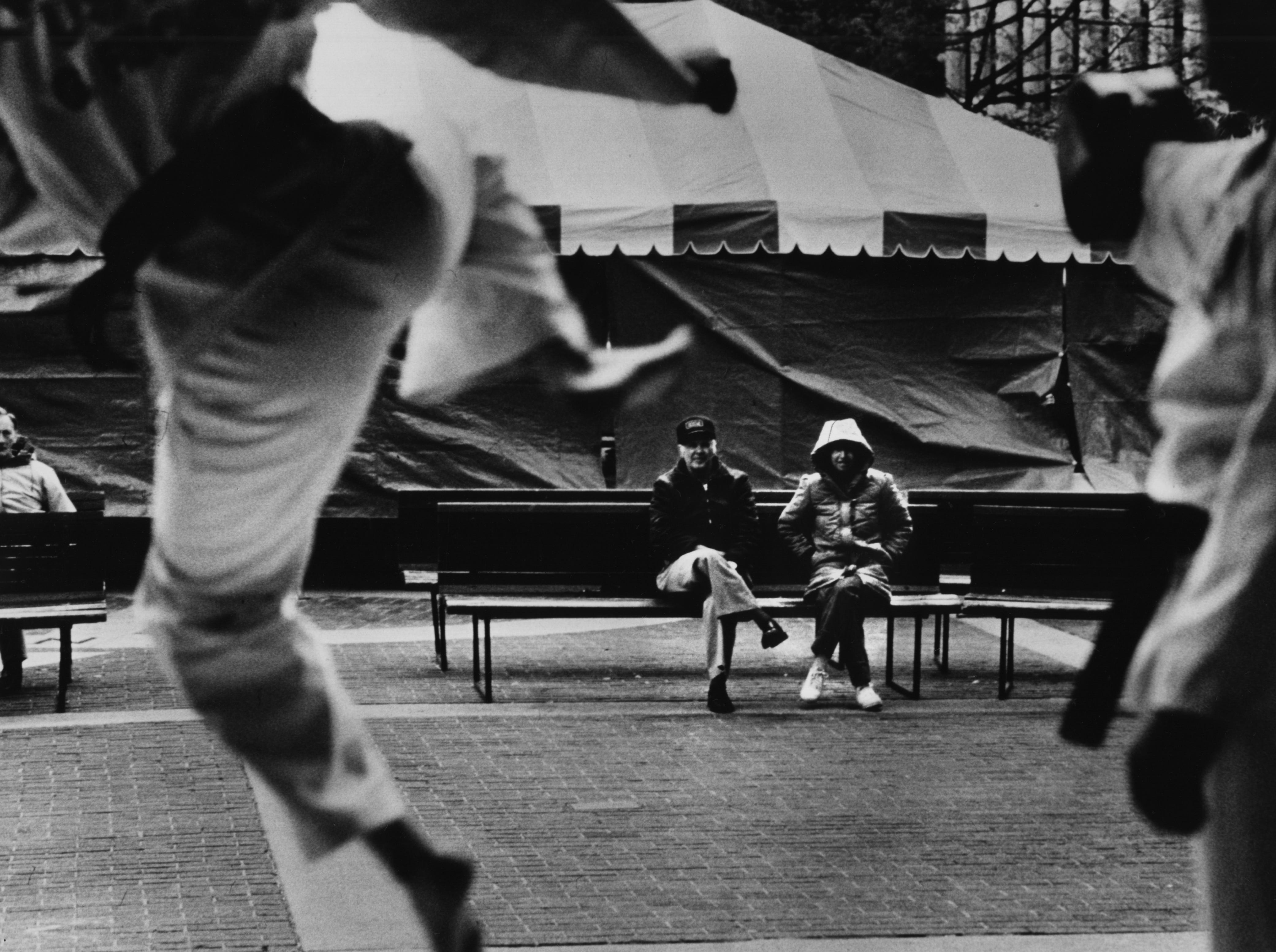 Dewey Linkous and Delois Godsey watch a Taekwondo demonstration during the Dogwood Arts Festival April 8, 1988 at Market Square.