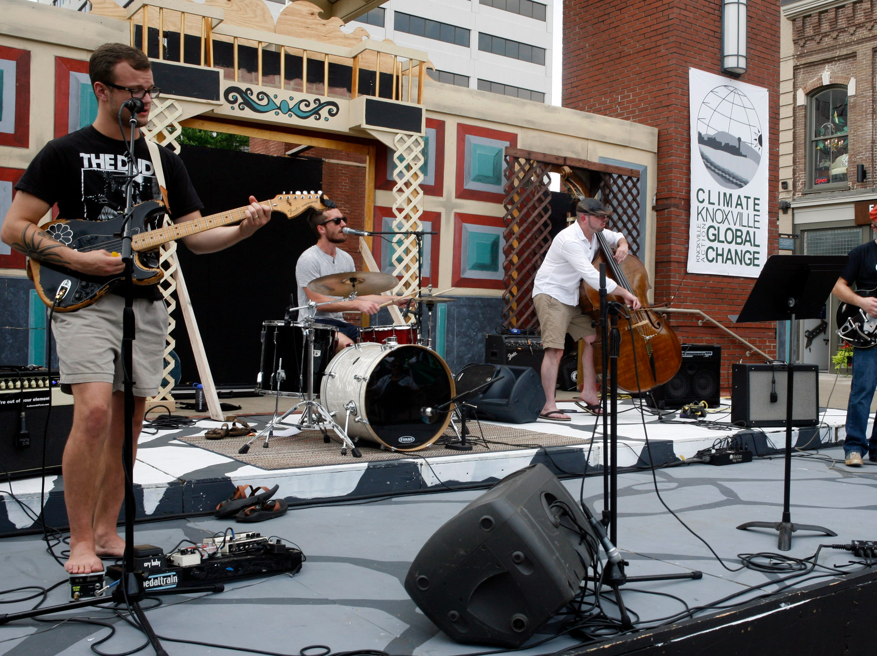 The band Chambers performs during an action event held by Climate Knoxville on Market Square. (Photo by Wade Payne, Special to the News Sentinel)