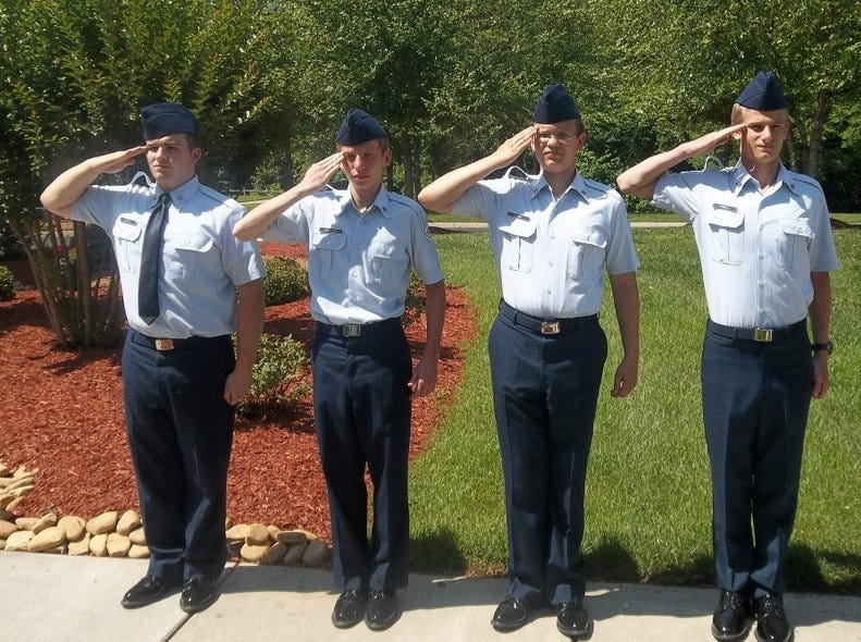 The Clinton High School/Dragon Squadron Air Force JROTC performed a special flag-folding ceremony for the residents at Morning Pointe of Clinton. From left, Nick Brown, Richard Hilgerson, Brian Moore and Lucas Powell.