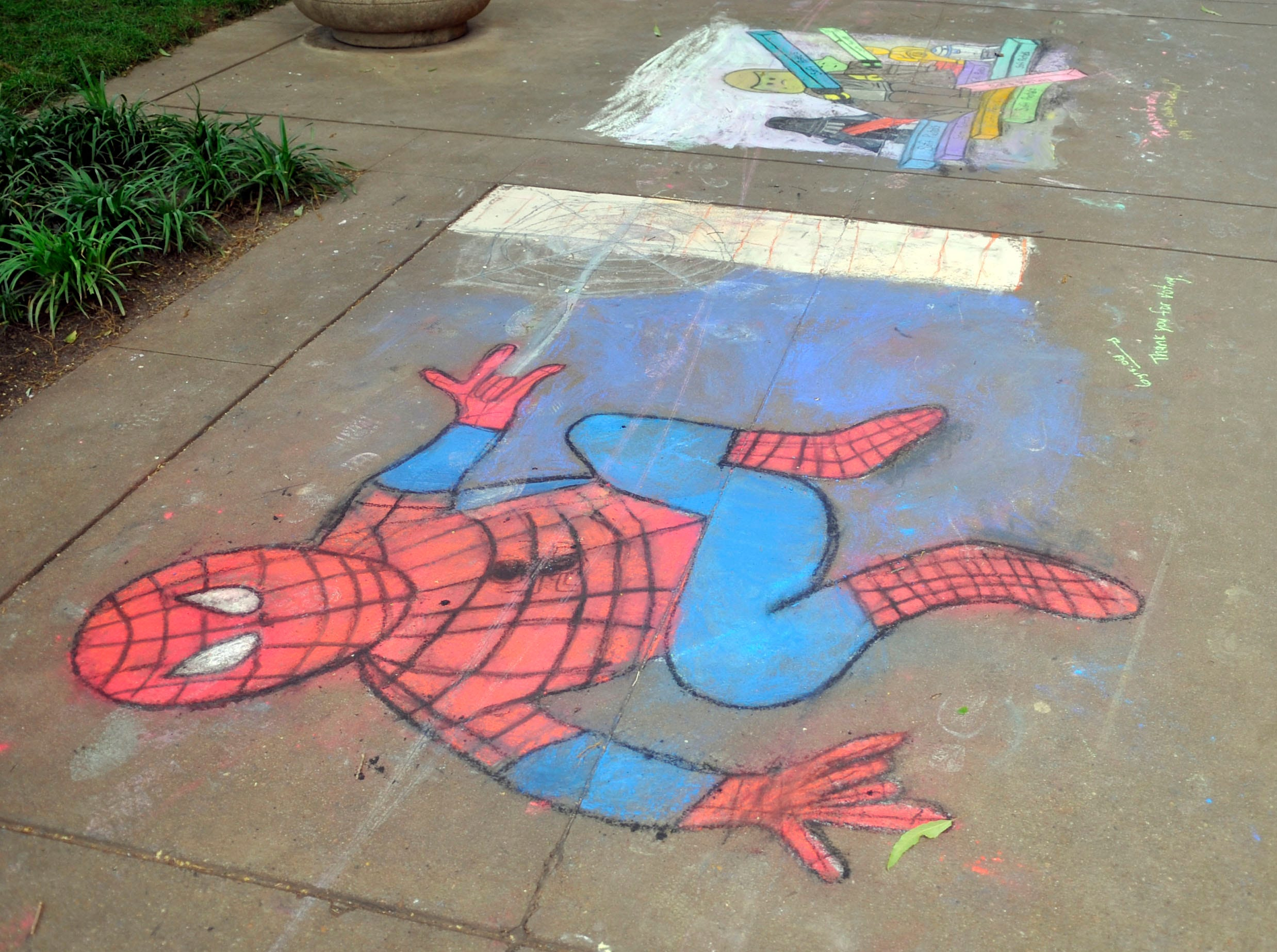 Market Square side walks are decorated with art from the Dogwood Arts Festival Chalk Walk. Over the weekend Knoxville area of all ages and skill level used the downtown sidewalks as their canvas  during this years street painting festival.