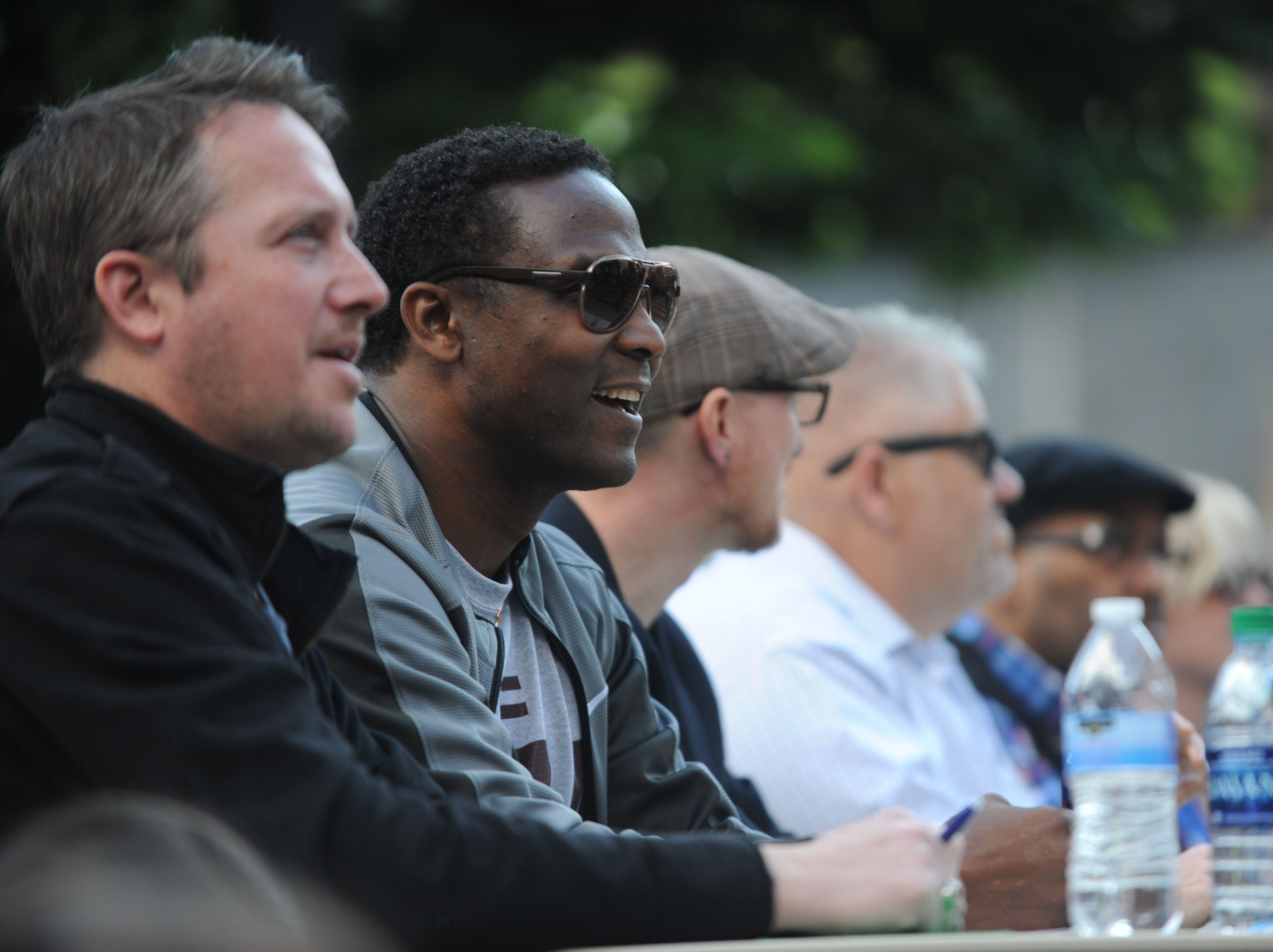 Former University of Tennessee quarterback Sterling Henton is one of the CTE Goes Live judges and watches the performance in Market Square on Friday, May 6, 2016.