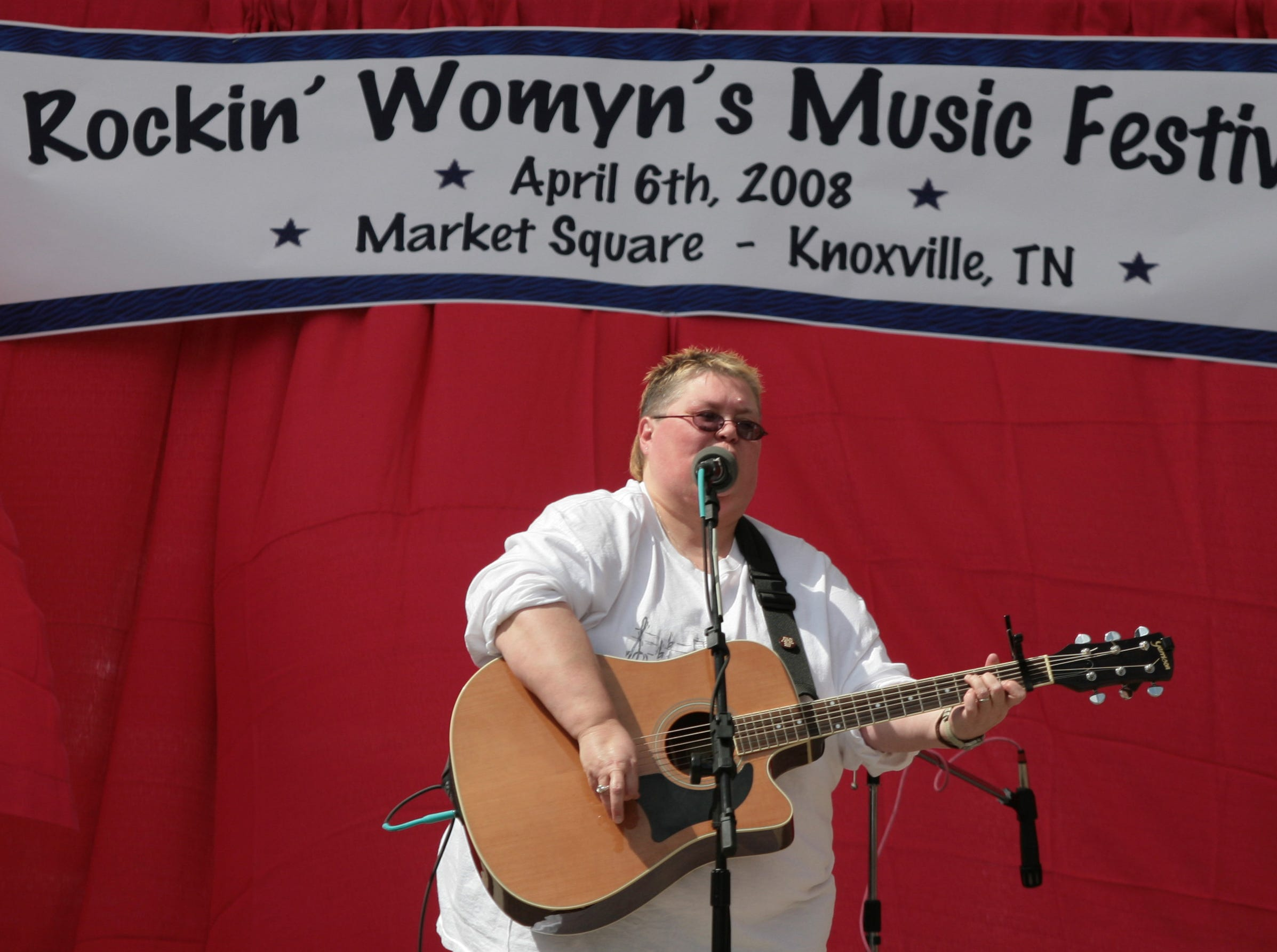Karen Reynolds performs a song during the 2nd annual Rockin' Womyn's Music Festival on Sunday on Market Square. More than ten acts performed at the festival put on by the Lambda Student Union with proceeds going to support the Family Justice Center.