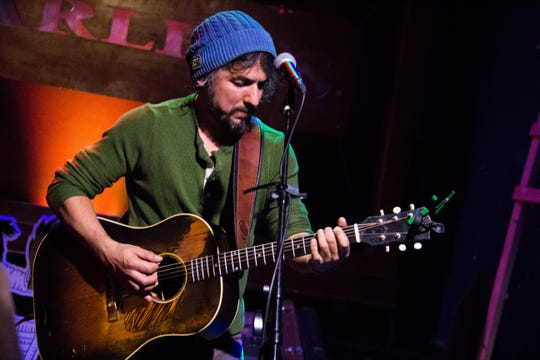 Cruz Contreras of The Black Lillies performs at Barley's in Knoxville during a Rhythm N' Blooms headliner reveal party Nov. 27, 2018.