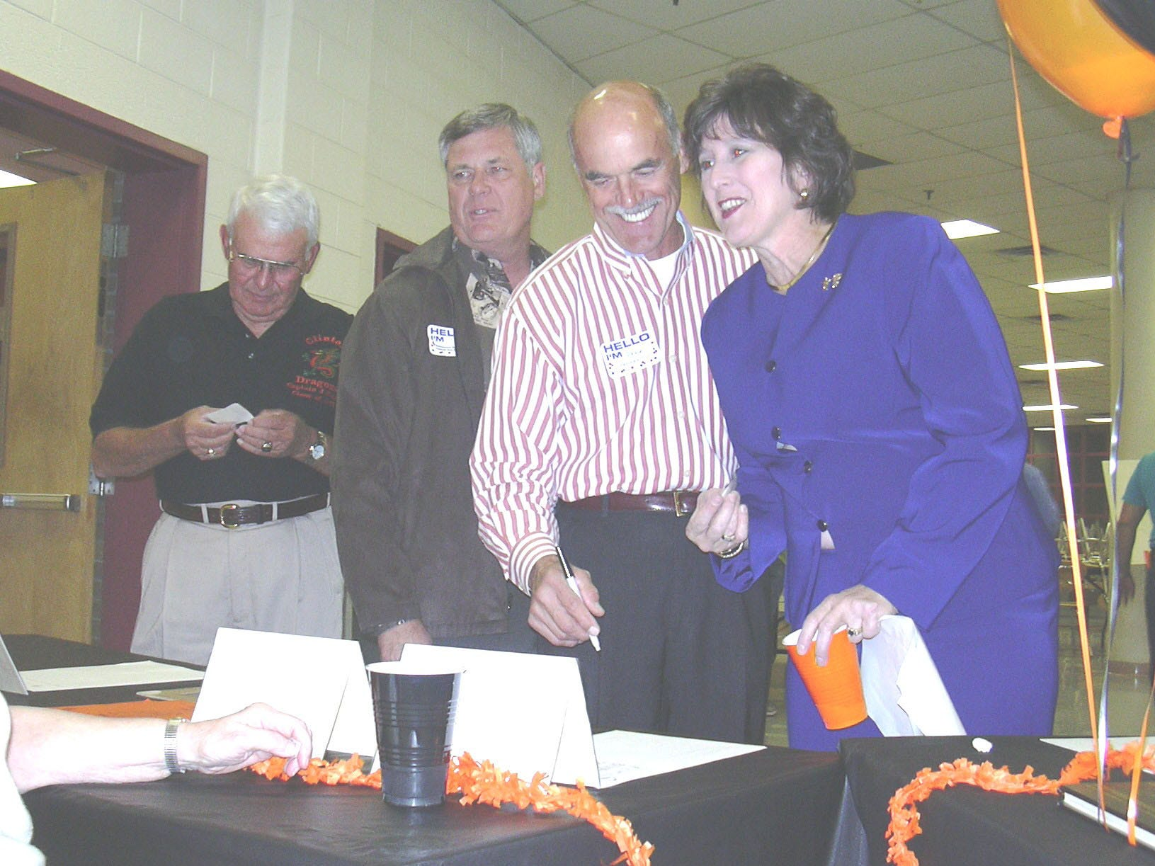 Four well-known alumni of Clinton High School sign the guest register in the years designated for their respective classes during the celebration of the school's anniversary. From left: Former County Commissioner Jack Rains, State Rep. Jim Hackworth, D-Clinton, Clinton auctioneer William ``Bear'' Stephenson and Lana Seivers, Tennessee's commissioner of education. 2003