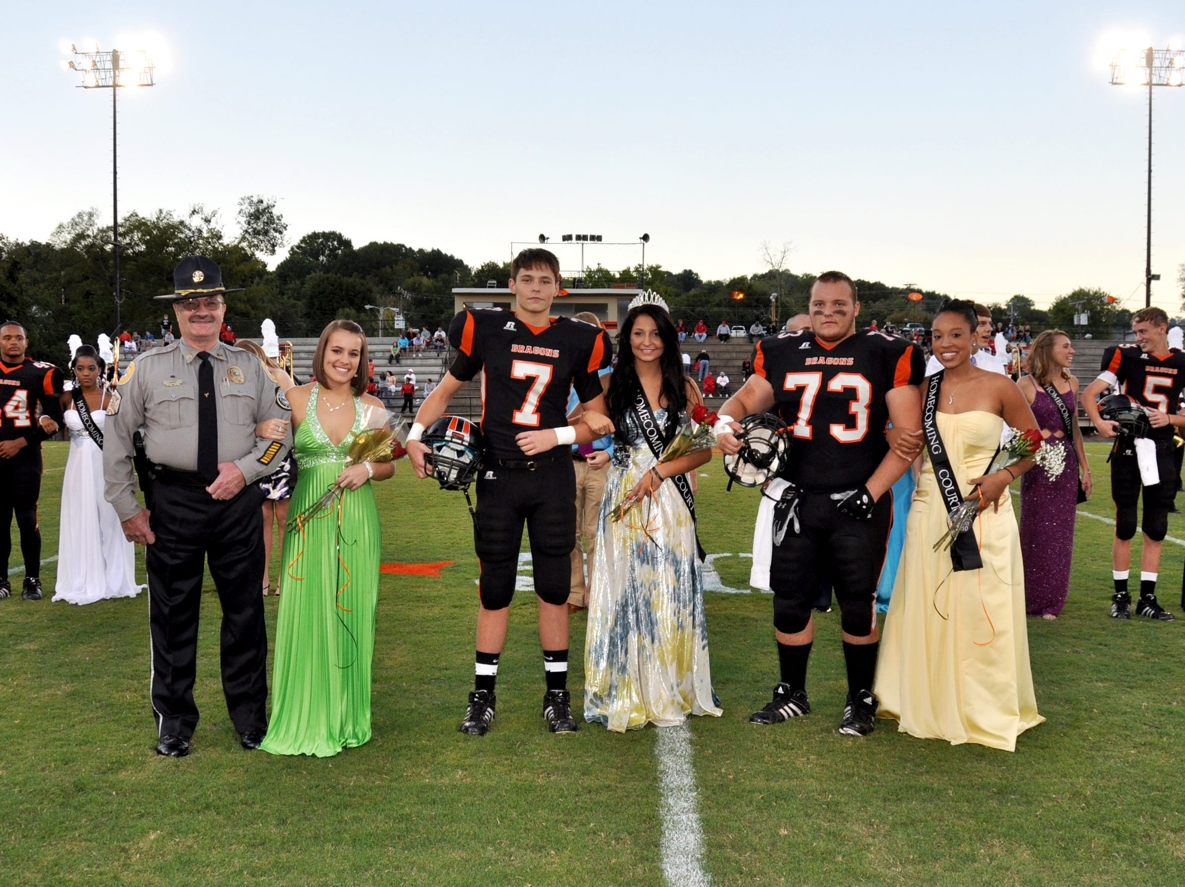 The 2010 Clinton High School Homecoming court and their escorts included, from left, Officer C.H. Bean escorting second runner-up Sarah Bean, Stephen Antonelli escorting homecoming queen Tricia Antonelli, and James Stearns escorting first runner-up Shawna Cotham.