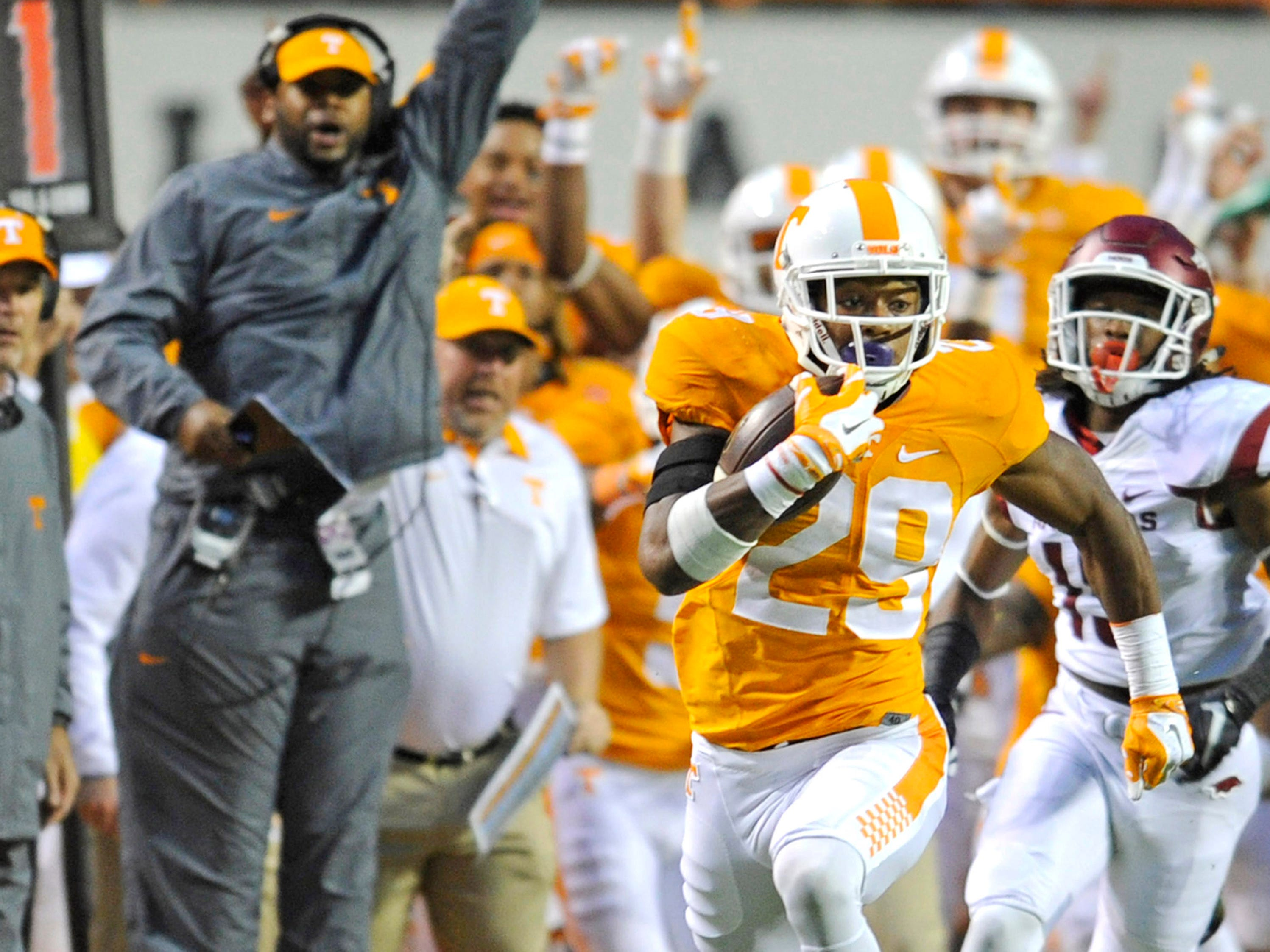 Tennessee head coach Butch Jones and coaches react on the sideline as Tennessee defensive back Evan Berry (29) returns a kickoff for touchdown during the first half at Neyland Stadium in Knoxville, Tenn. on Saturday, Oct. 3, 2015. (AMY SMOTHERMAN BURGESS/NEWS SENTINEL)