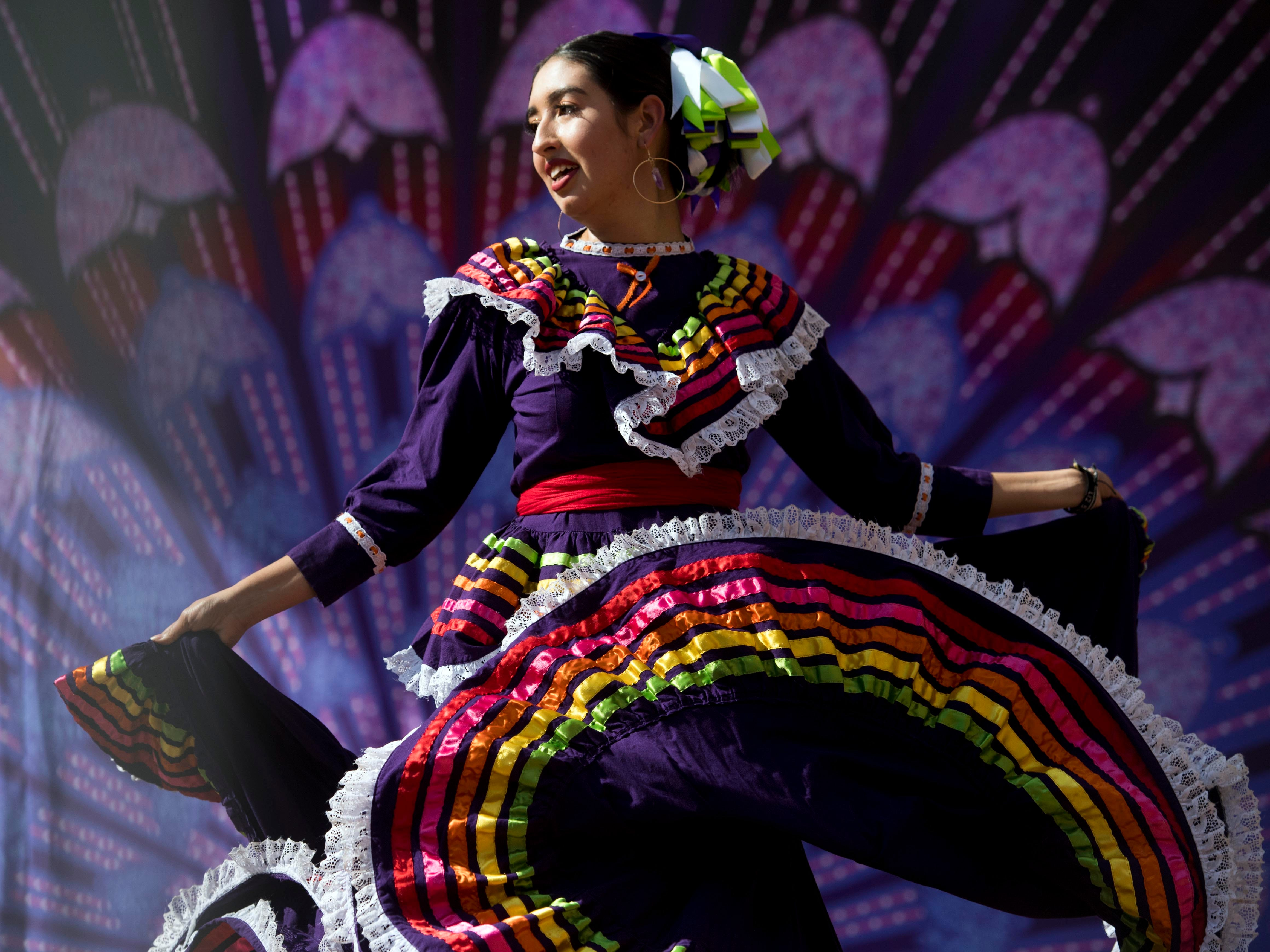 A dancer with Bellet folklórico Sol de Mexico performs on stage at the HoLa Hora Latina's annual HoLa Festival at Market Square on Sunday, September 30, 2018.