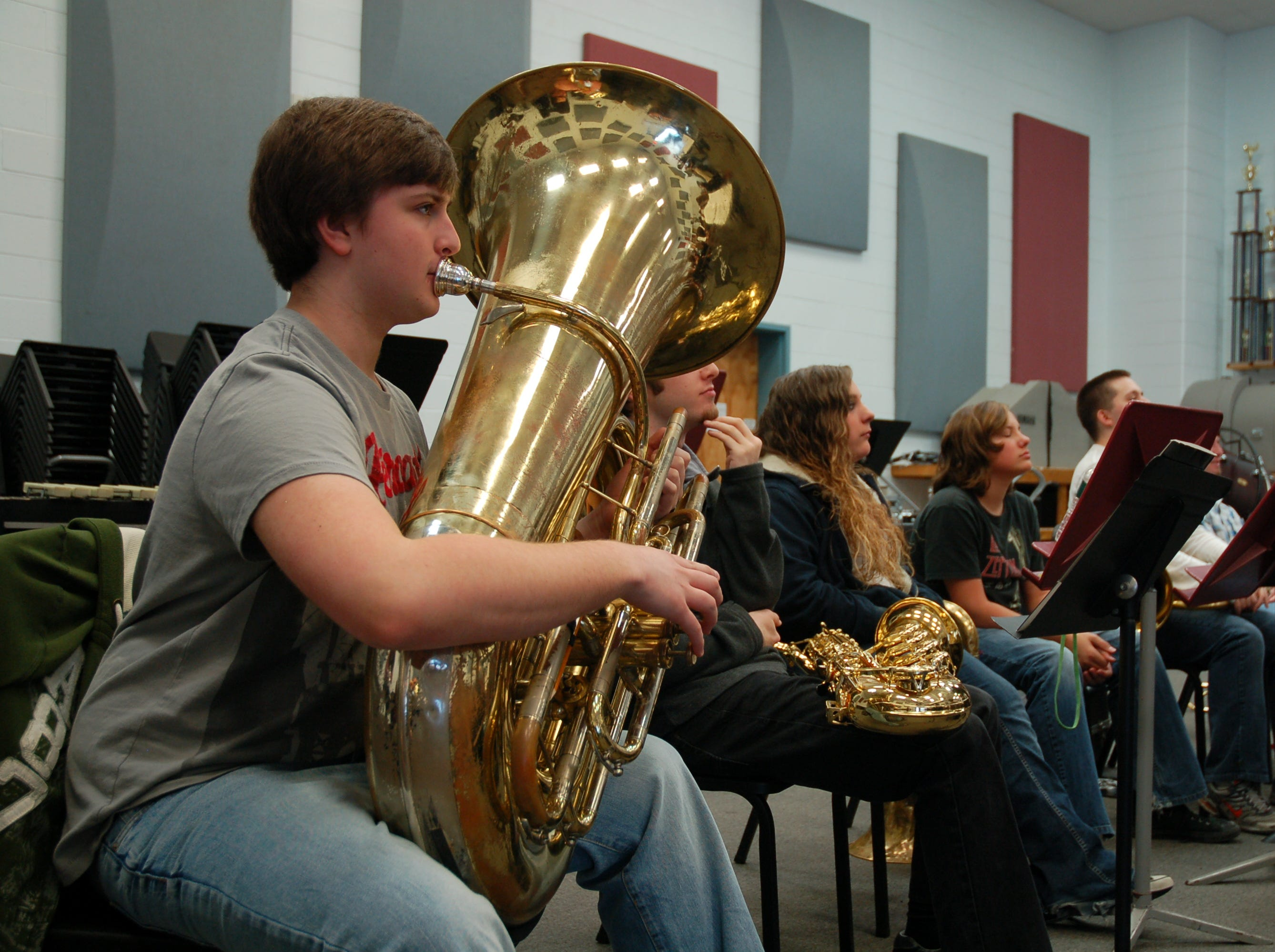 John Paul Powers sits in the back row, ready to play, during Clinton High School band practice on March 29, 2011. John Paul, 15, recently won a Southeastern U.S. tuba competition.
