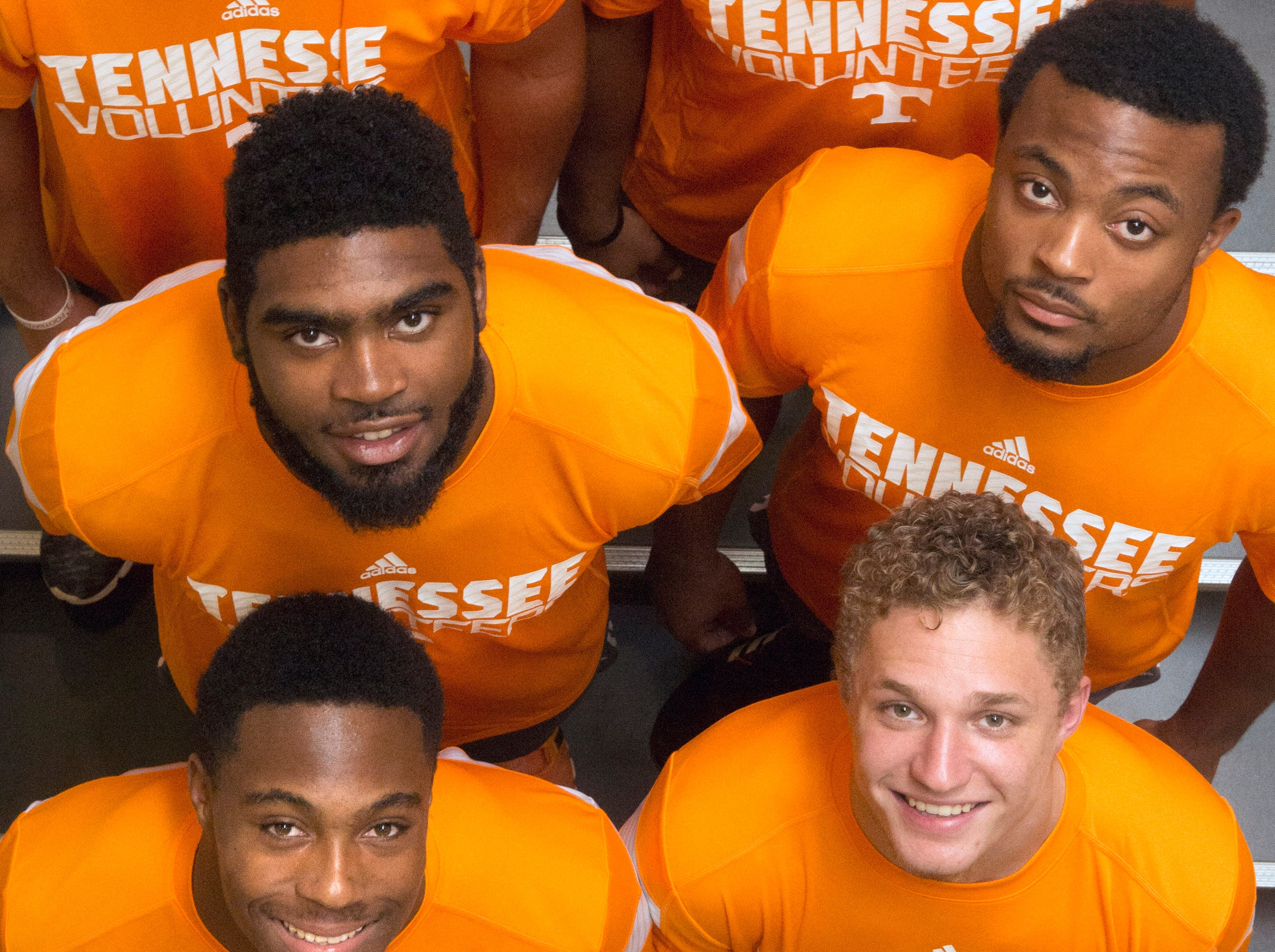 Tennessee football team freshmen, clockwise from top left, Dillon Bates, Todd Kelly, Jr., Elliot Berry, Vic Wharton, Evan Berry, and Neiko Creamer pose for a portrait at the University of Tennessee Anderson Training Center in Knoxville on Friday, July 18, 2014. (ADAM LAU/NEWS SENTINEL)