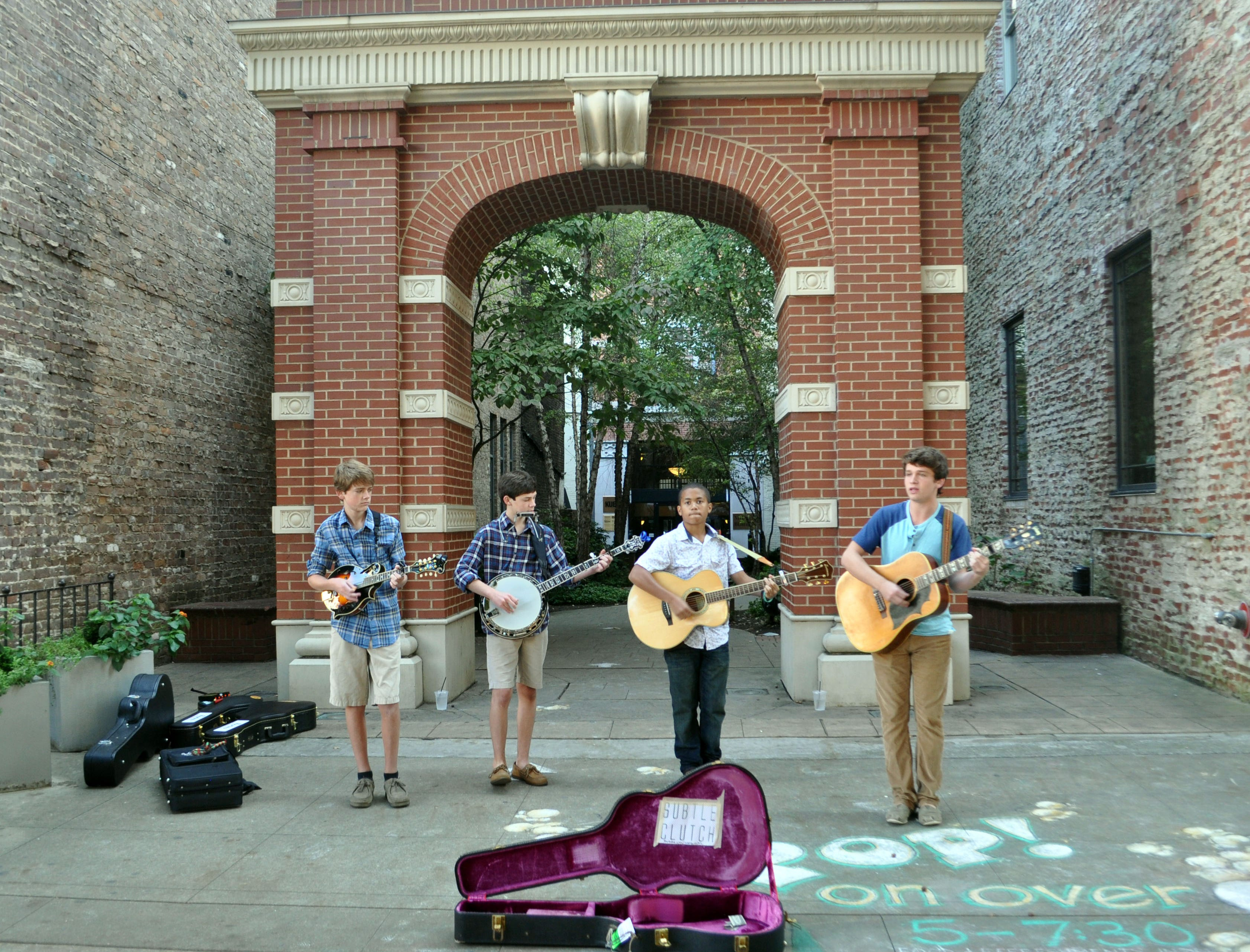 From left, Subtle Clutch members Jonathan Bailey, Eli Fox, Devin Badgett and Briston Maroney perform in Market Square. The group first took to the Square stage in June of last year and play there as often as their schedules allow.
