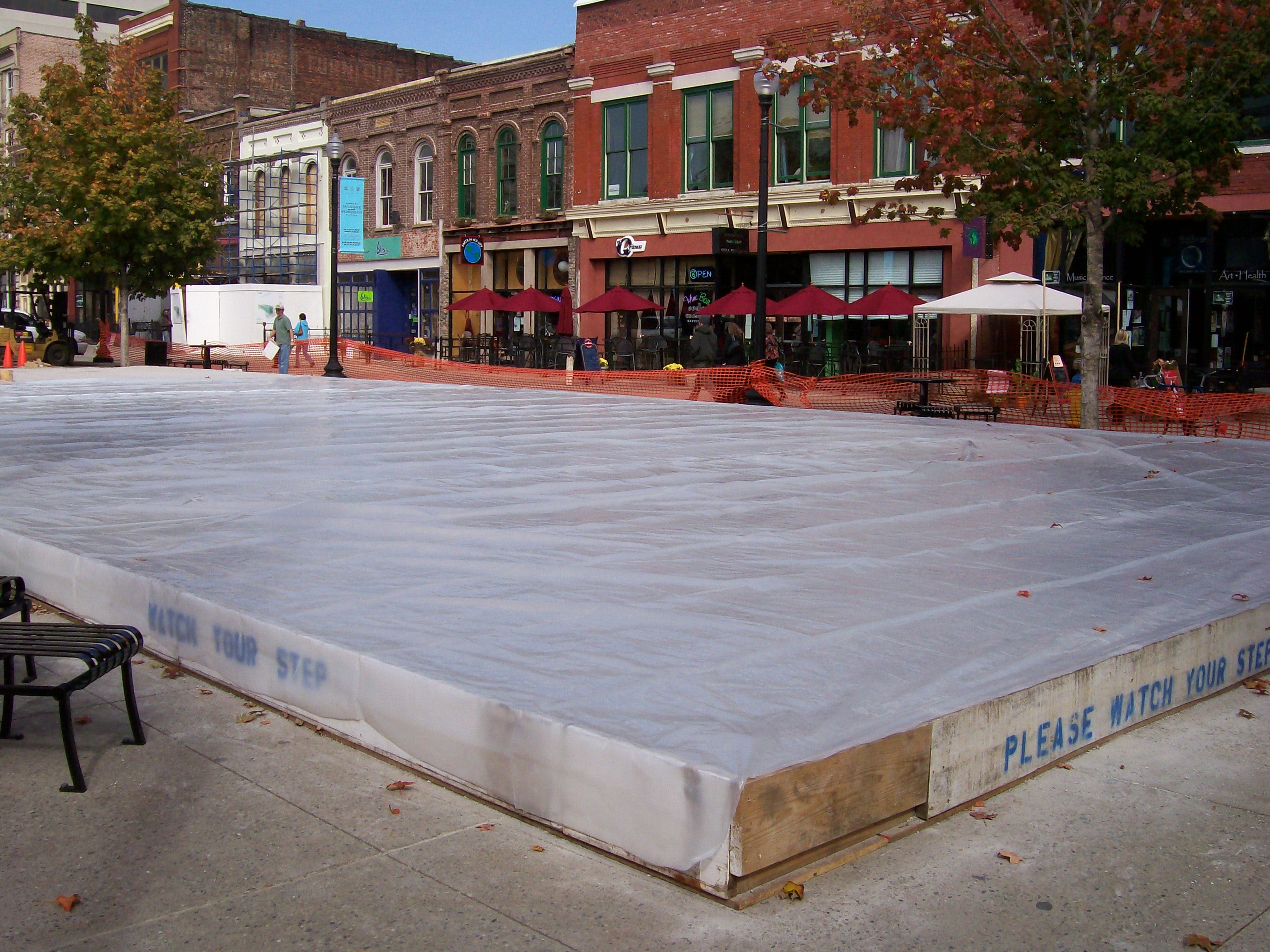 Steps in the construction of Knoxville's Holiday on Ice at Market Square. 