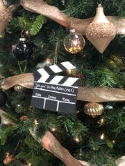 Mini clapperboards decorate the Old Hollywood Glamor tree designed by Halls Art Club members.