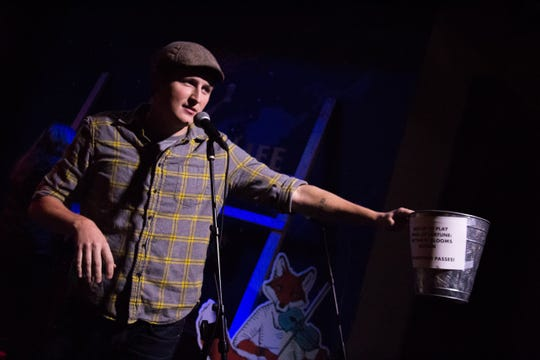 Garrett Thomson asks for entries to play Wheel of Fortune at Barley's to reveal Rhythm N' Blooms headliners on Nov. 27, 2018.
