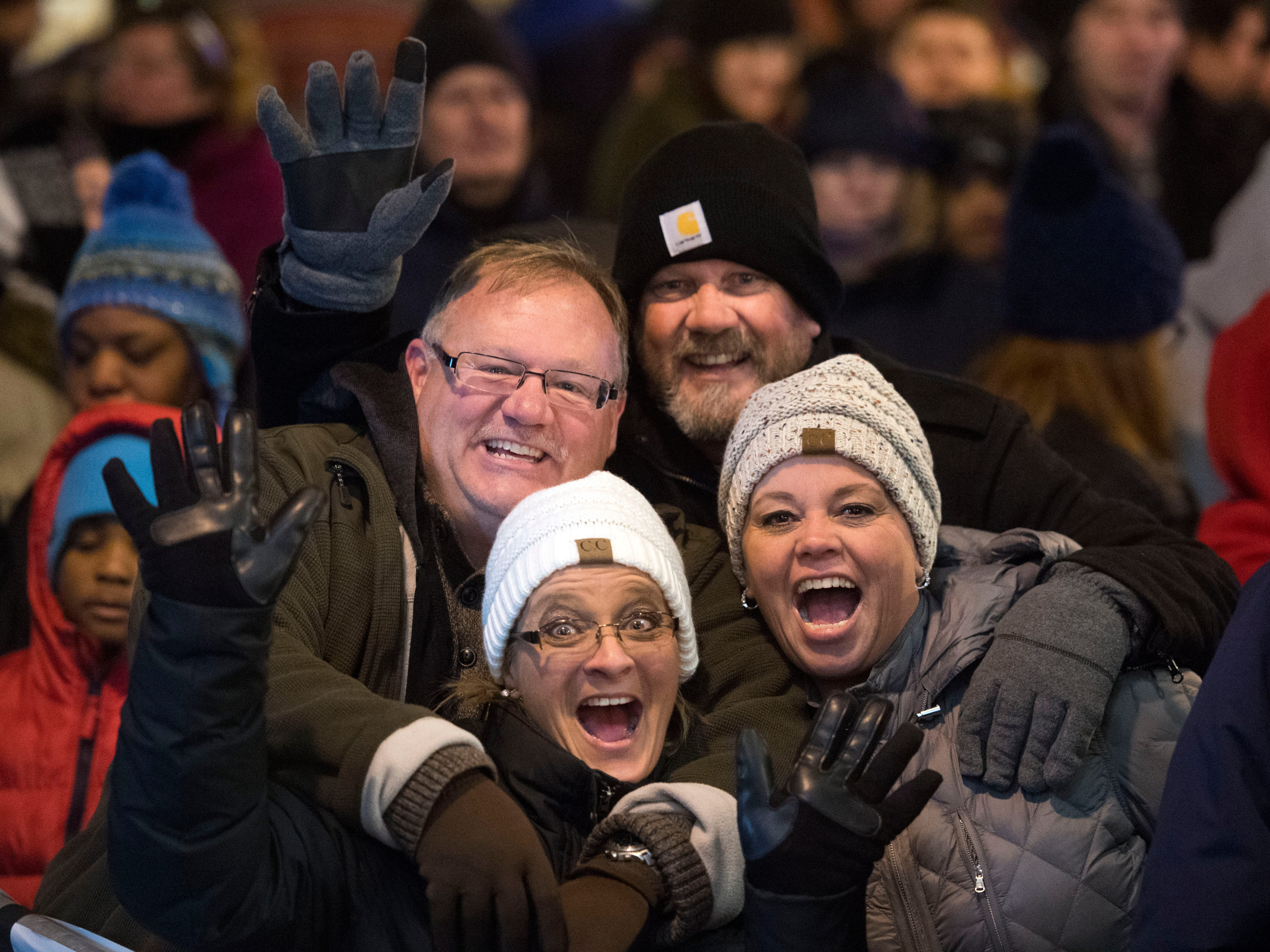 New Year's Eve celebrants Kenny and Kristi Long, left, and Jeff and Angie Brown discover a camera is pointed at them while they celebrate at Market Square on Sunday, December 31, 2017.