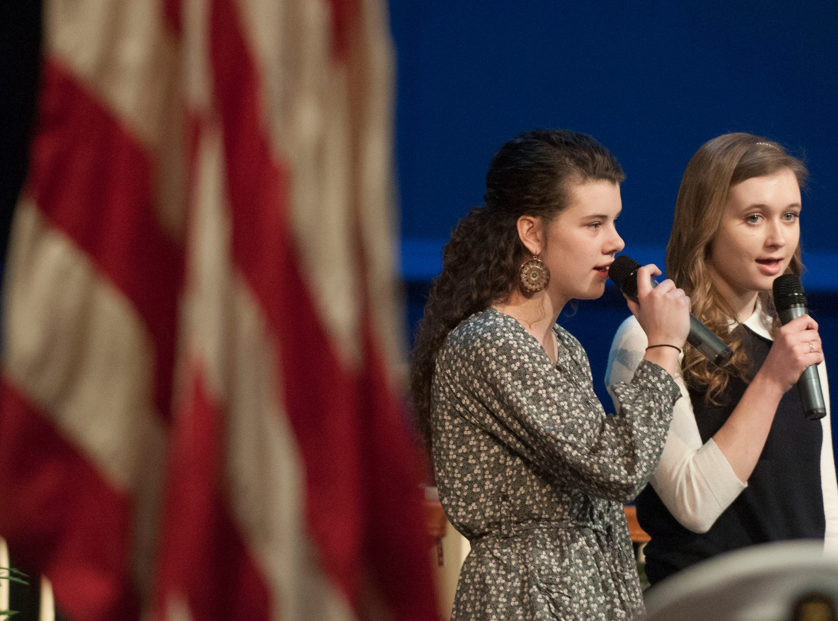 Clinton High School Students Emmie Merritt, left and Lauren Headrick, right sang the National Anthem a the start of the kick off for the Gear Up program. Former University of Tennessee football player Todd Kelly was the keynote speaker for the  Gear Up kick off at Second Baptist Church in Clinton Thursday January 24, 2013.