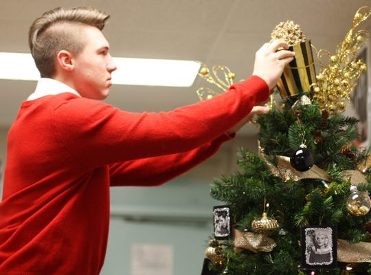 "Gage Kitts, a Halls High School junior, had already visited the independent living facility and came up with the overall theme for their art club project. ""It had a very old Hollywood feel,"" said Kitts."