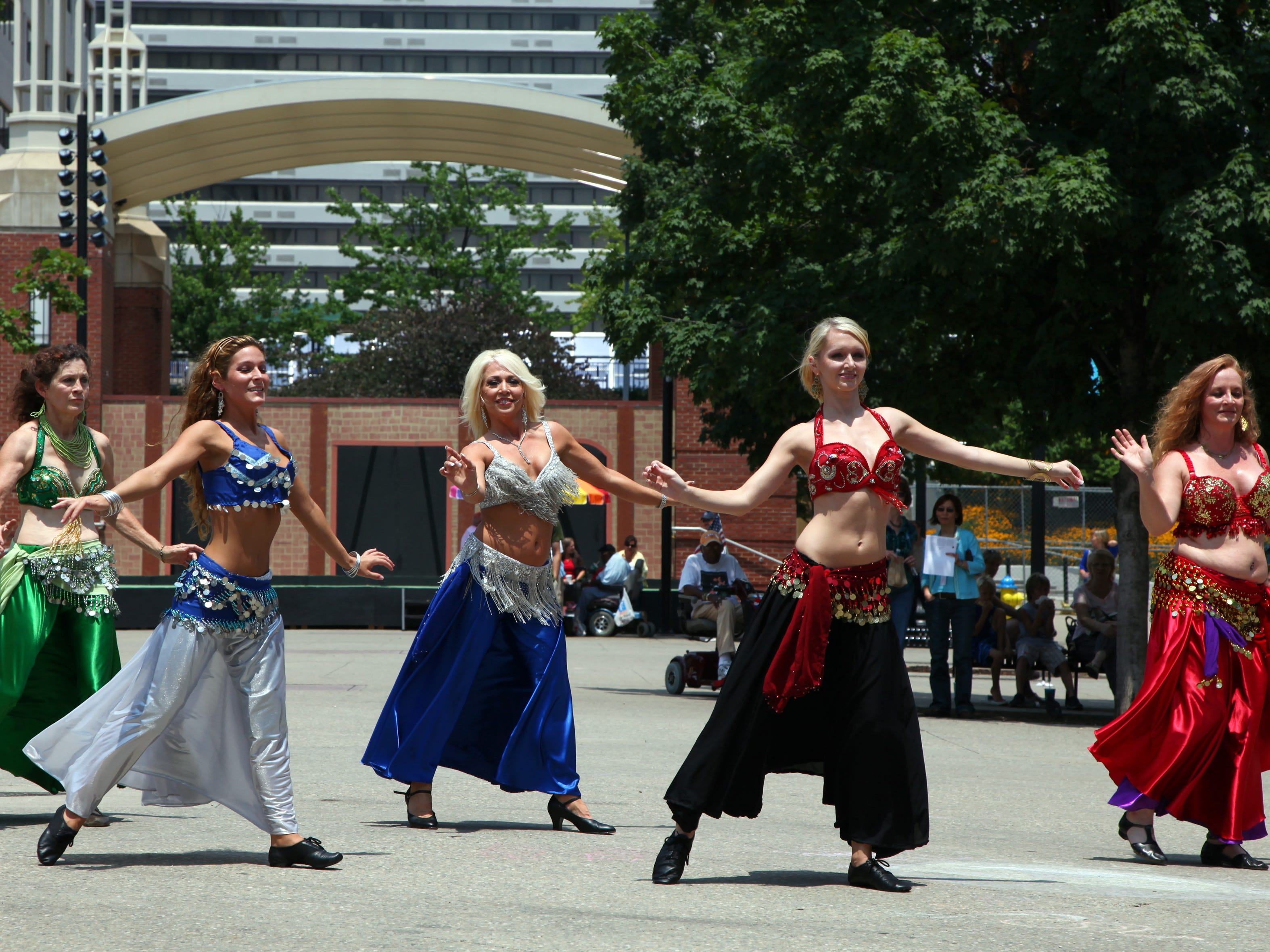 The Sandsation Dancers, from left, Kippy Greene, Mia Brasseaux, instructor Sandy Larson, Cathryn Chipley, and Melody Deakin perform a belly dance routine on Market Square Friday, July 10, 2009.  Larson teaches a belly dance class through the Knoxville Arts and Fine Crafts Center and brought her class out to perform during the lunch hour.