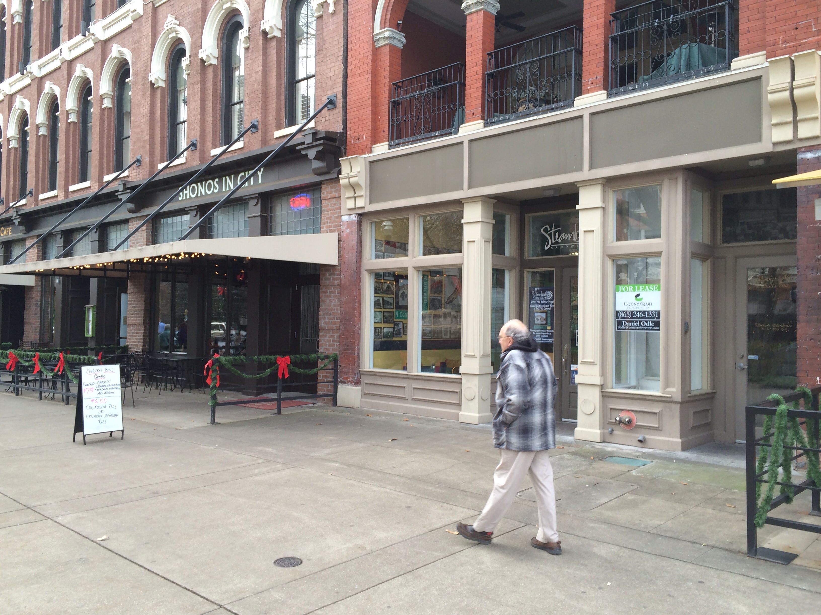 A pedestrian walks by the Steamboat Sandwiches and Shonos in City buildings on Market Square, on Friday.