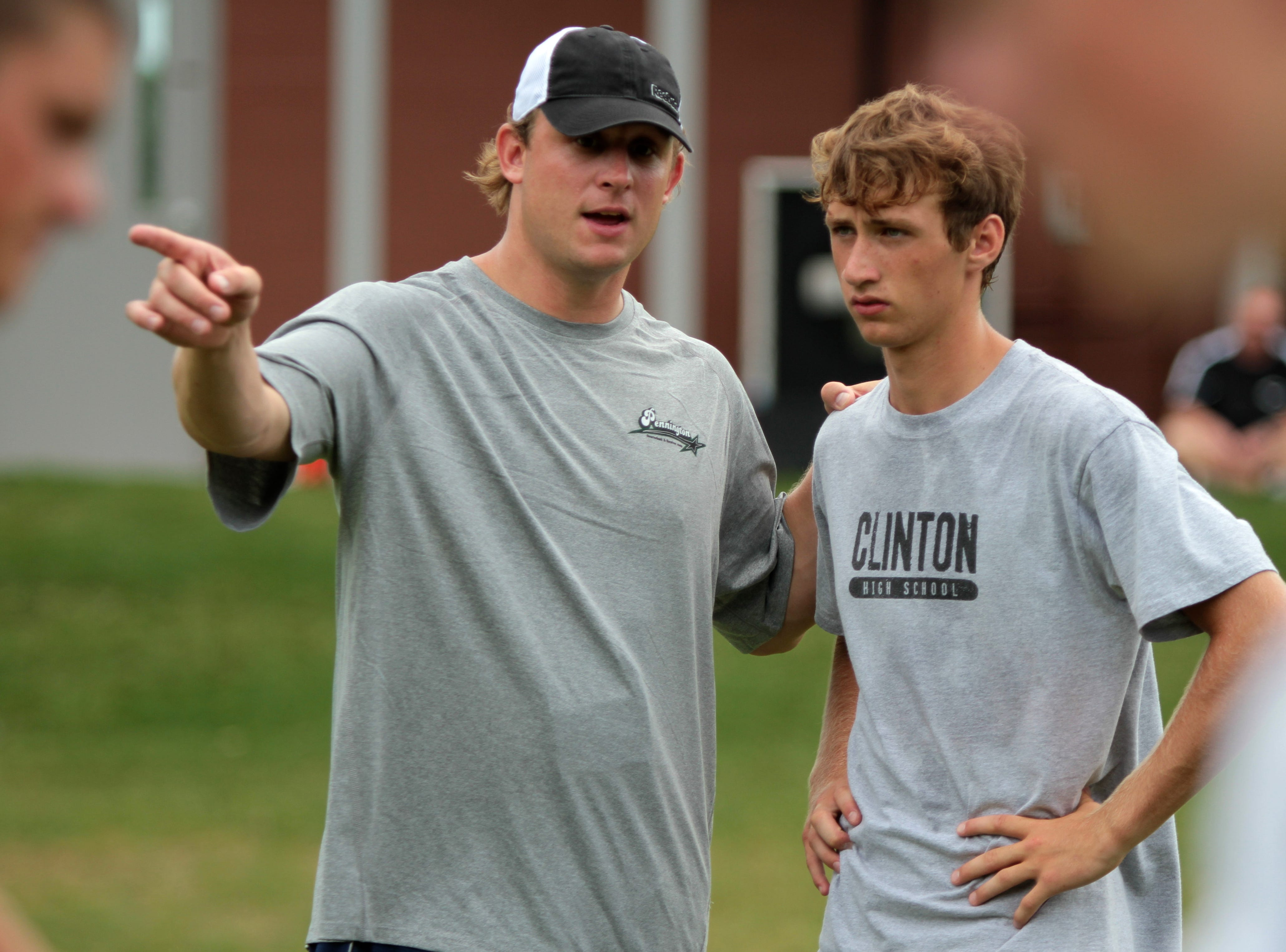 Chad Pennington, left, talks with Alex Willard, 16, of Clinton High School during the 12th annual Chad Pennington Football Quarterbacks and Receivers Camp at Webb School on Tuesday, July 12, 2011.