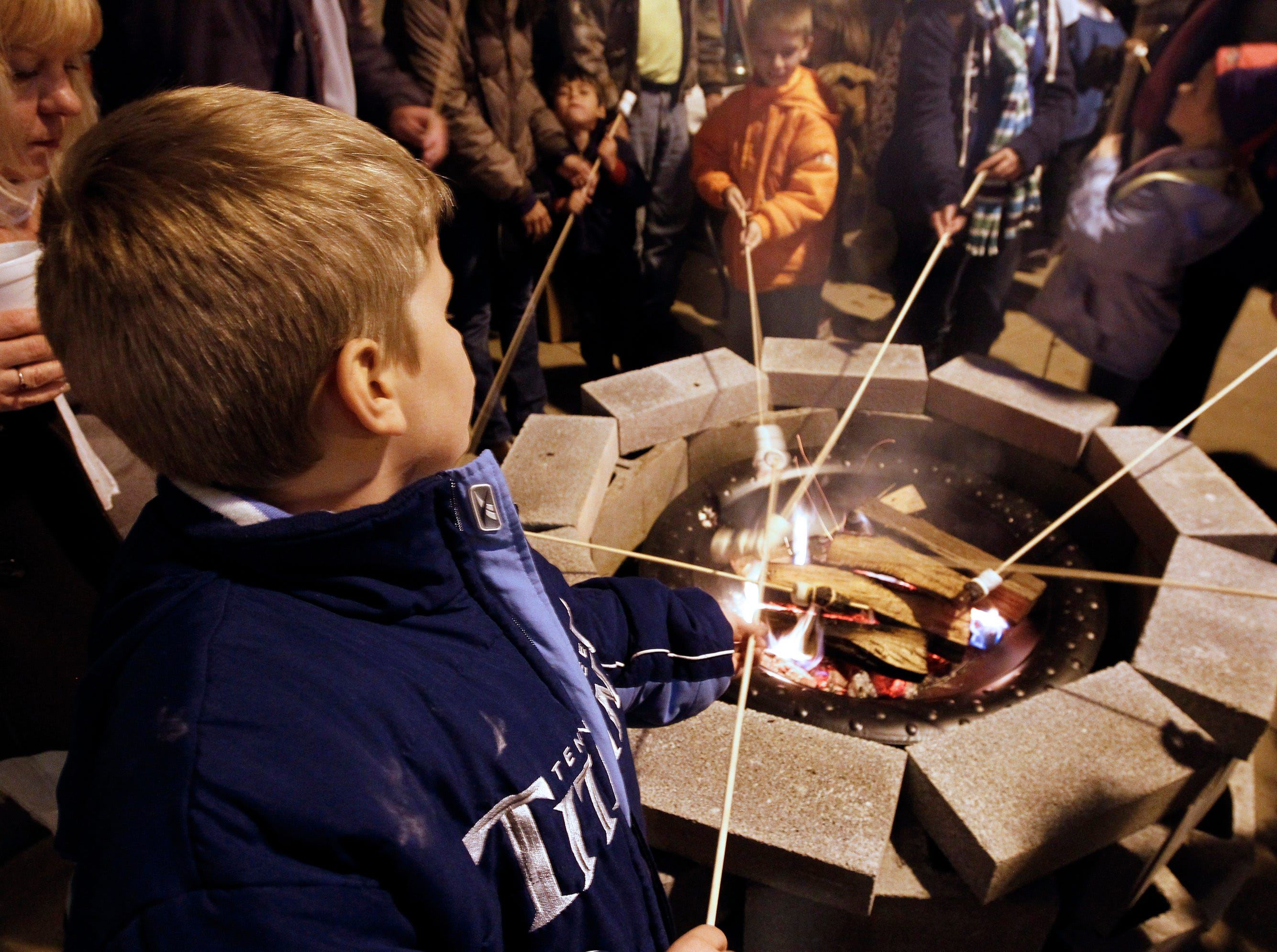 Tristian Neff of Kingston roasts marshmellows at fire pit on Market Square Friday, Nov. 25, 2011. (Photo by Wade Payne, Special to the News Sentinel)