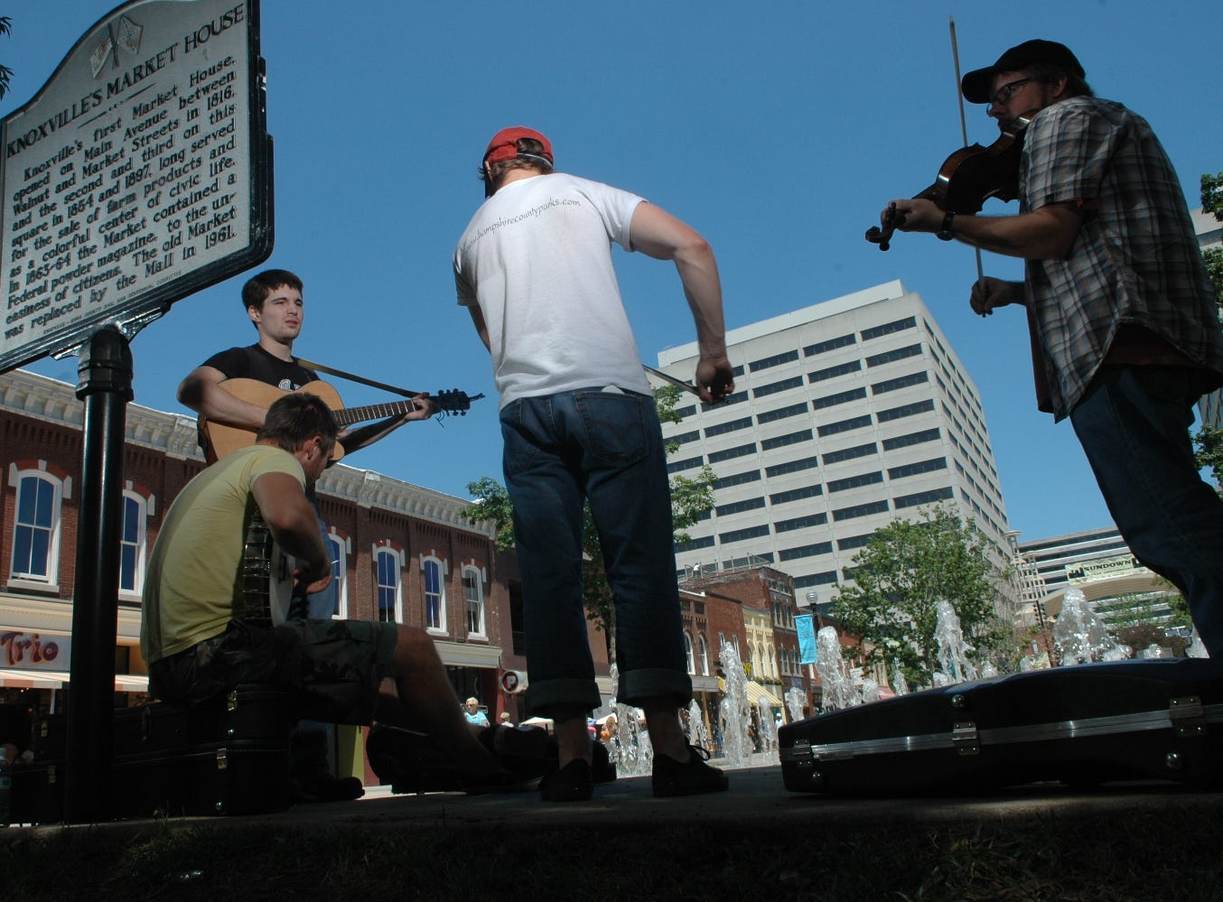 "Musicians, from left, John Mills, Matt Metz, Ben Townsend, and Greg Horne play a tune titled ""Crackshot"" on Thursday, June 21 at Market Square. Hailing from Romney, West Virginia, and calling themselves the Fox Hunt,  the band is in town for gigs including two appearances on WDVK's Plate Plate Special show (Horne is a local fiddle player who is sitting in with the boys). ""We're out here making enough money to make it back to West Virginia,"" said Townsend.  Photo by Paul Efird, Knoxville News Sentinel staff"