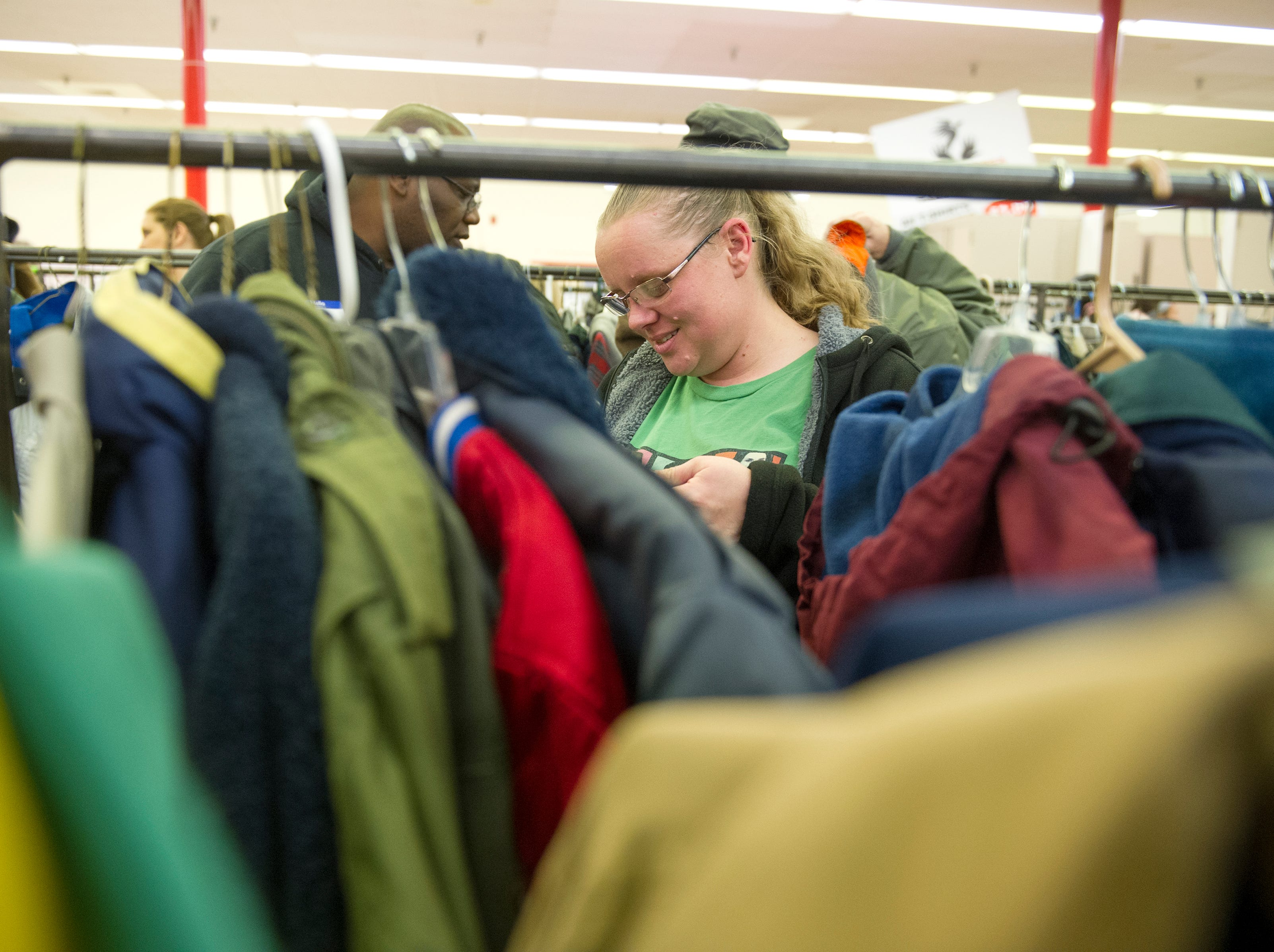 Linda Smith peruses the vast coat selection during KARM's 30th annual Coats for the Cold coat drive in Knoxville Saturday, Dec. 5, 2015.