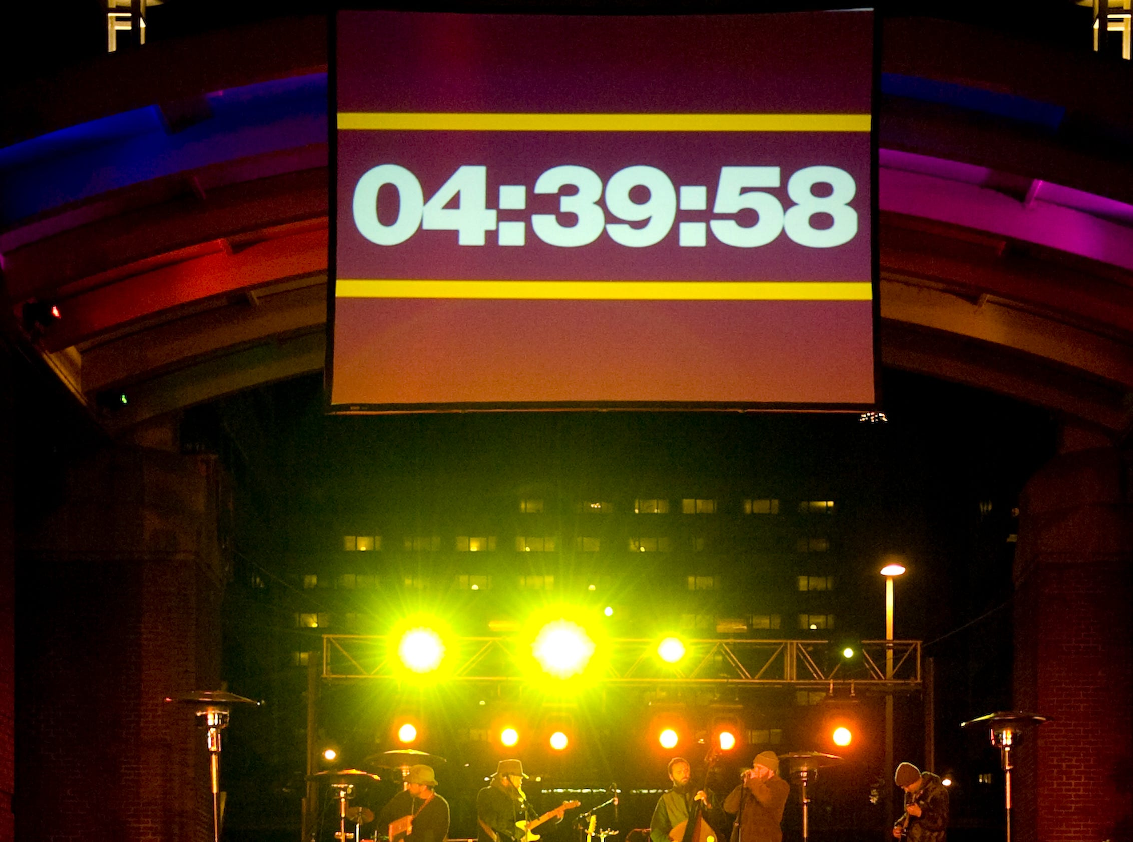 A large clock counts down the remaining hours to New Year's Day at the First Night festivities at Market Square.