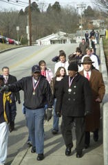 "Alfred Williams, left, recalls a memory from the days 50 years ago when he was one of the original ""Clinton 12"" who became the first black students to integrate formerly all-white Clinton High School, on Feb. 10, 2006. Also pictured in front during the reenactment of those walks is another member of that group, Bobby Cain."