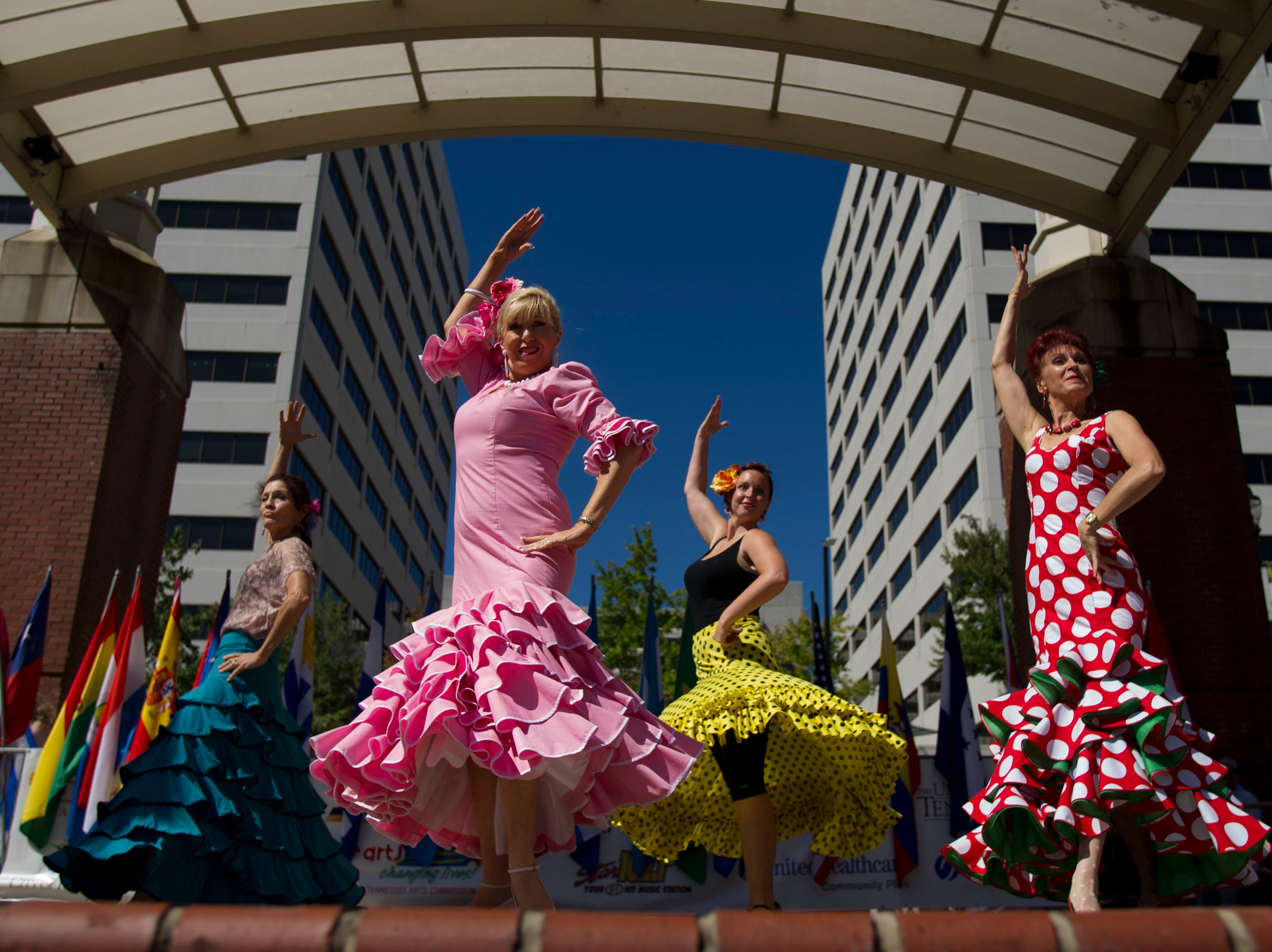 Members of Pasion Flamenca West Knoxville, from left, Catherine Green, Sharon Mansoor, Martha Prewitt, and Lucia Androsnescu Flamenco dance for the crowd at the Hola Festival at Market Square on Sunday, September 22, 2013 