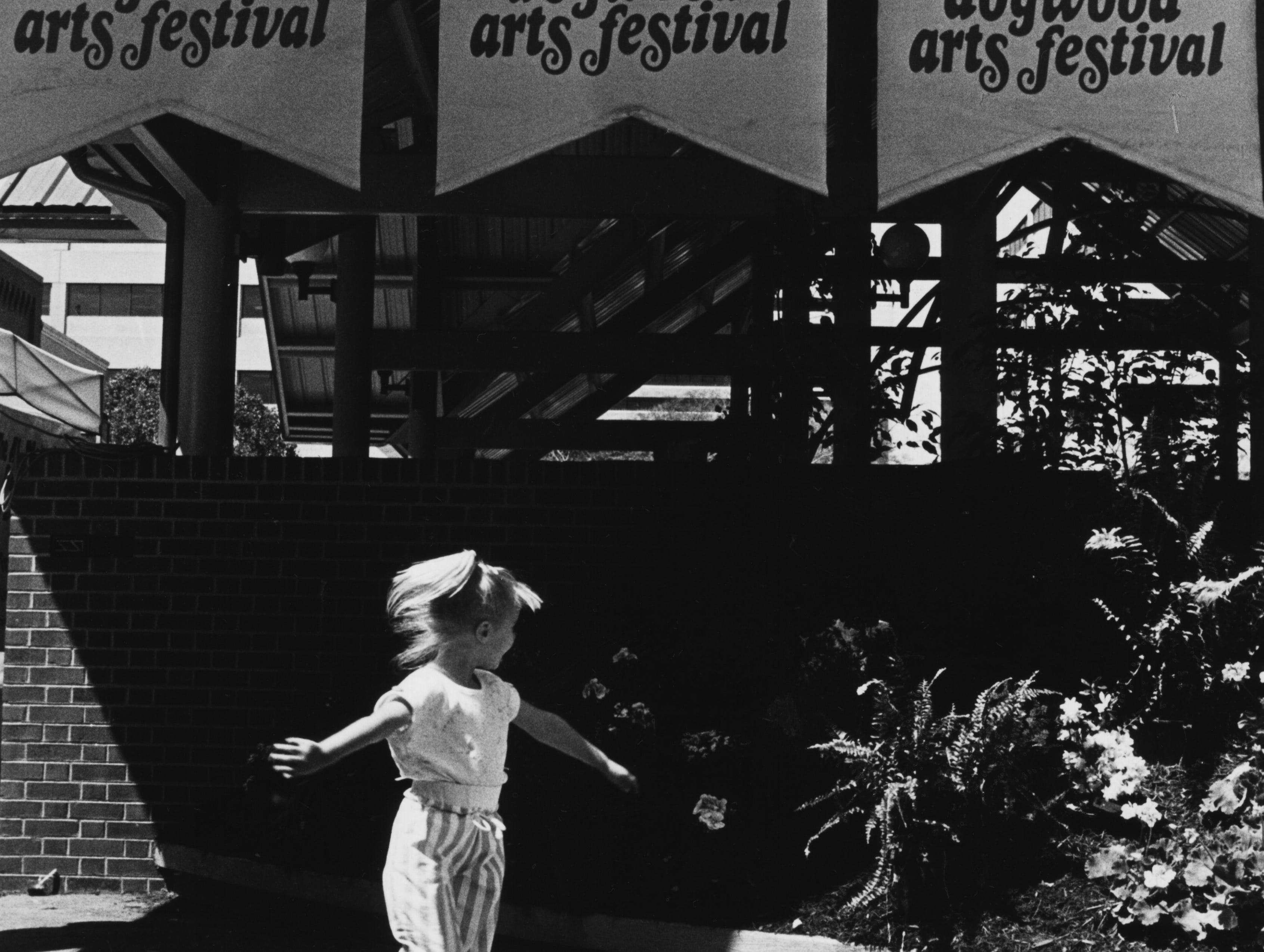 Ashley Hood, 3, from Maryville enjoys opening day of the 27th annual Dogwood Arts Festival April 11, 1987 at Market Square.