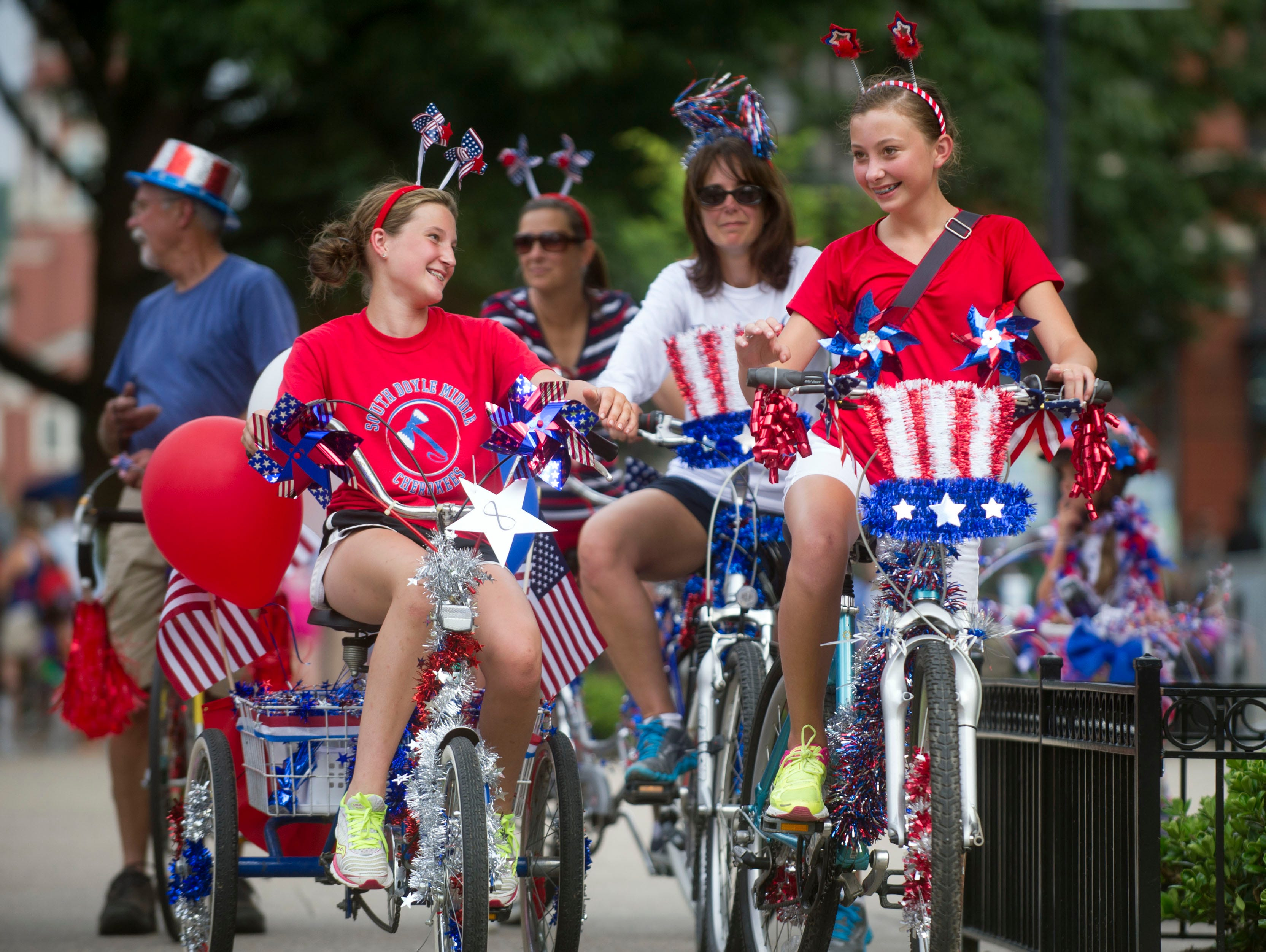 Olivia Snapp, foreground left, and Shelby Reynolds, right, wait to participate in the Patriotic Bike Parade at Market Square on Thursday, June 27, 2013. Also with them are, from background left, Mike Rule, Laura Snapp, and Kristi Reynolds. The Parade is one of the many events for the City of Knoxville's Festival on the Fourth celebration. 