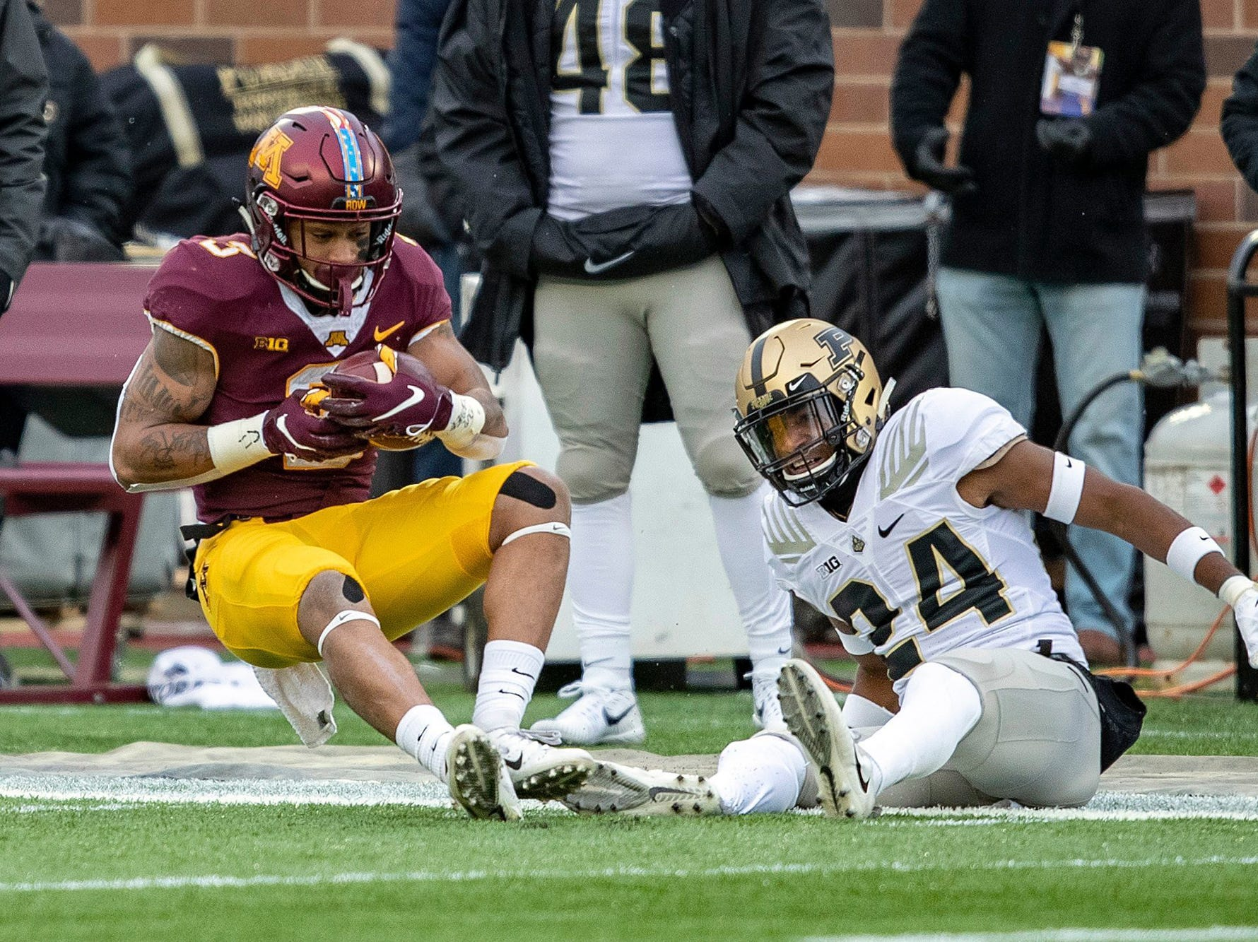 Minnesota's Chris Autman-Bell hauls in a pass against Purdue cornerback Tim Cason.