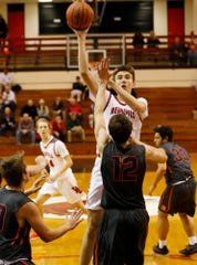 Rocco Muratori of West Lafayette with a shot over Jordan Walters of Harrison in the Franciscan Health Hoops Classic Tuesday, November 27, 2018, at Lafayette Harrison defeated West Lafayette 73-56.