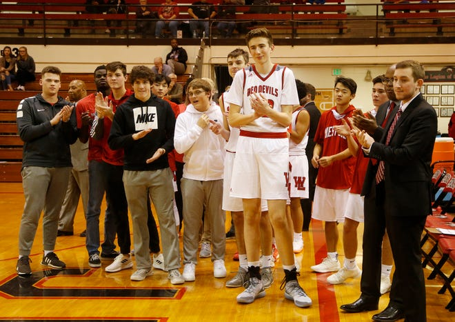 Rocco Muratori towers over his West Lafayette teammates as the Harrison Raiders are introduced before the start of their game in the Franciscan Health Hoops Classic Tuesday, November 27, 2018, at Lafayette Harrison defeated West Lafayette 73-56.