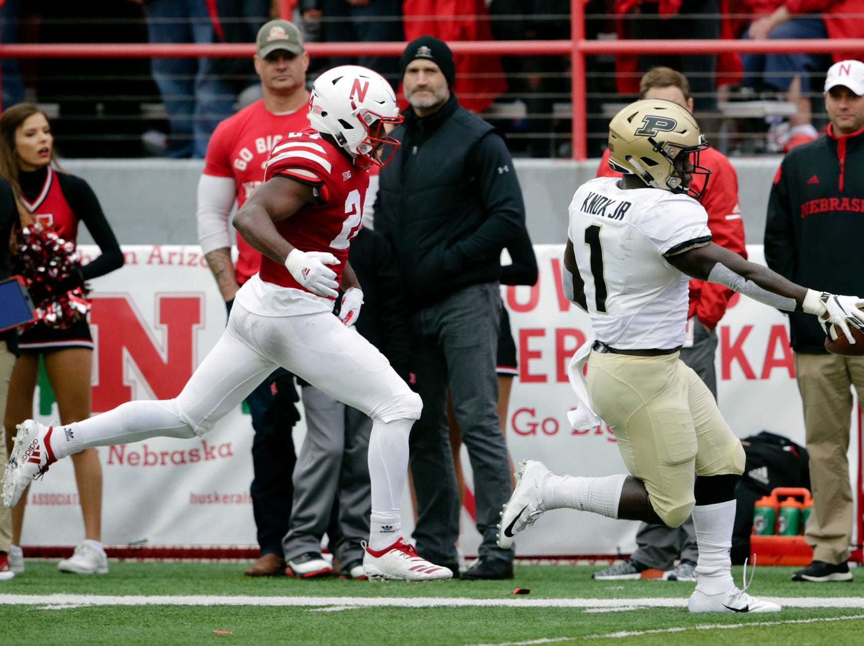 Purdue running back D.J. Knox (1) scores a touchdown ahead of Nebraska defensive back Aaron Williams (24) during the first half of an NCAA college football game in Lincoln, Neb., Saturday, Sept. 29, 2018.