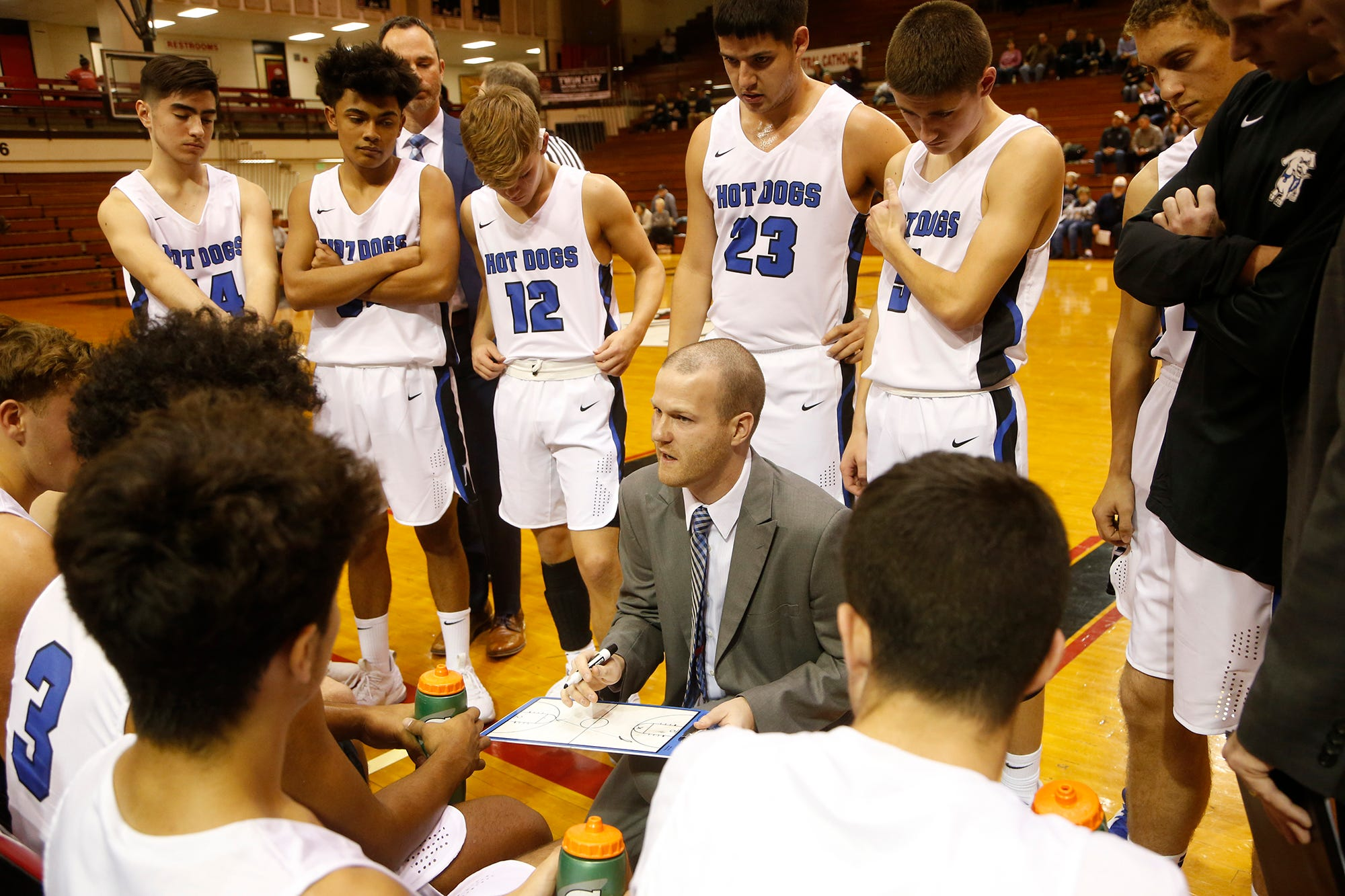Frankfort head coach Nate VanDuyne with instructions for the Hot Dogs as they face Central Catholic in the Franciscan Health Hoops Classic Tuesday, November 27, 2018, at Lafayette Jeff. CC defeated Frankfort 70-40.