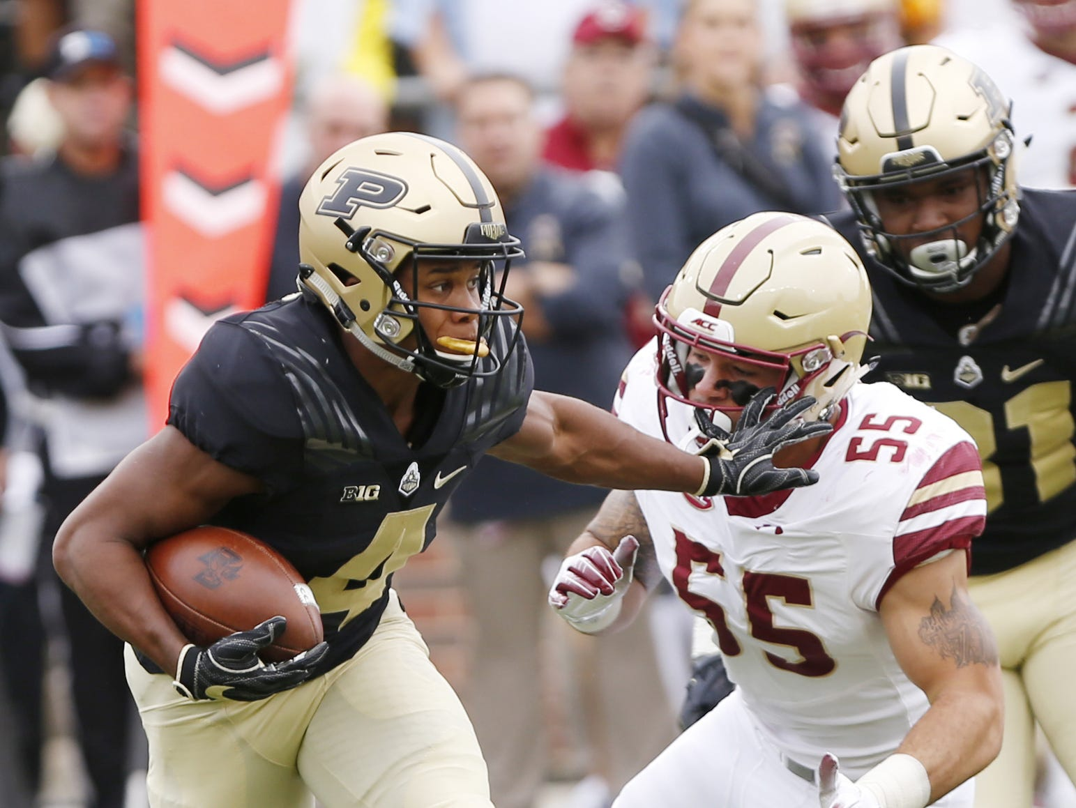 Rondale Moore of Purdue with a stiff arm to Isaiah McDuffie of Boston College on a kick return in the first half Saturday, September 22, 2018, in Ross-Ade Stadium. Purdue defeated Boston College 30-13.