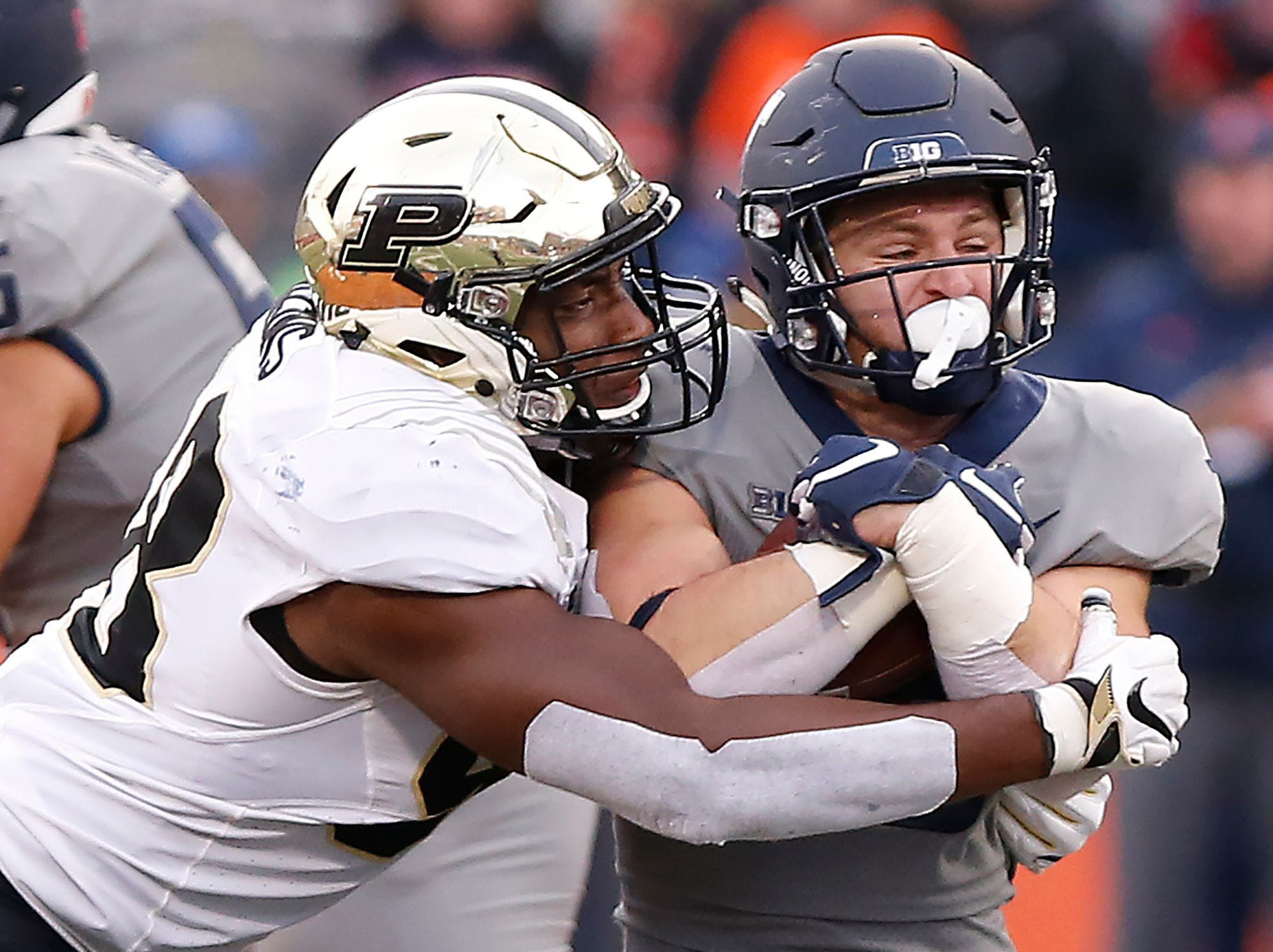 Purdue defensive end Kai Higgins brings down Mike Epstein of Illinois during the Boilermakers? 46-7 victory.