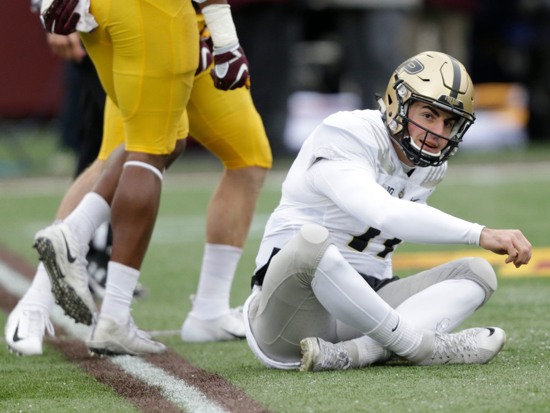 Purdue quarterback David Blough looks on after getting sacked by Minnesota in the second quarter.