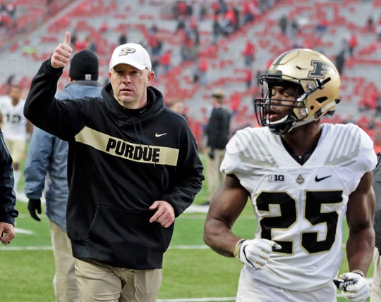 Purdue head coach Jeff Brohm gives a thumbs-up to fans as he leaves the field following an NCAA college football game against Nebraska in Lincoln, Neb., Saturday, Sept. 29, 2018. Purdue won 42-28.